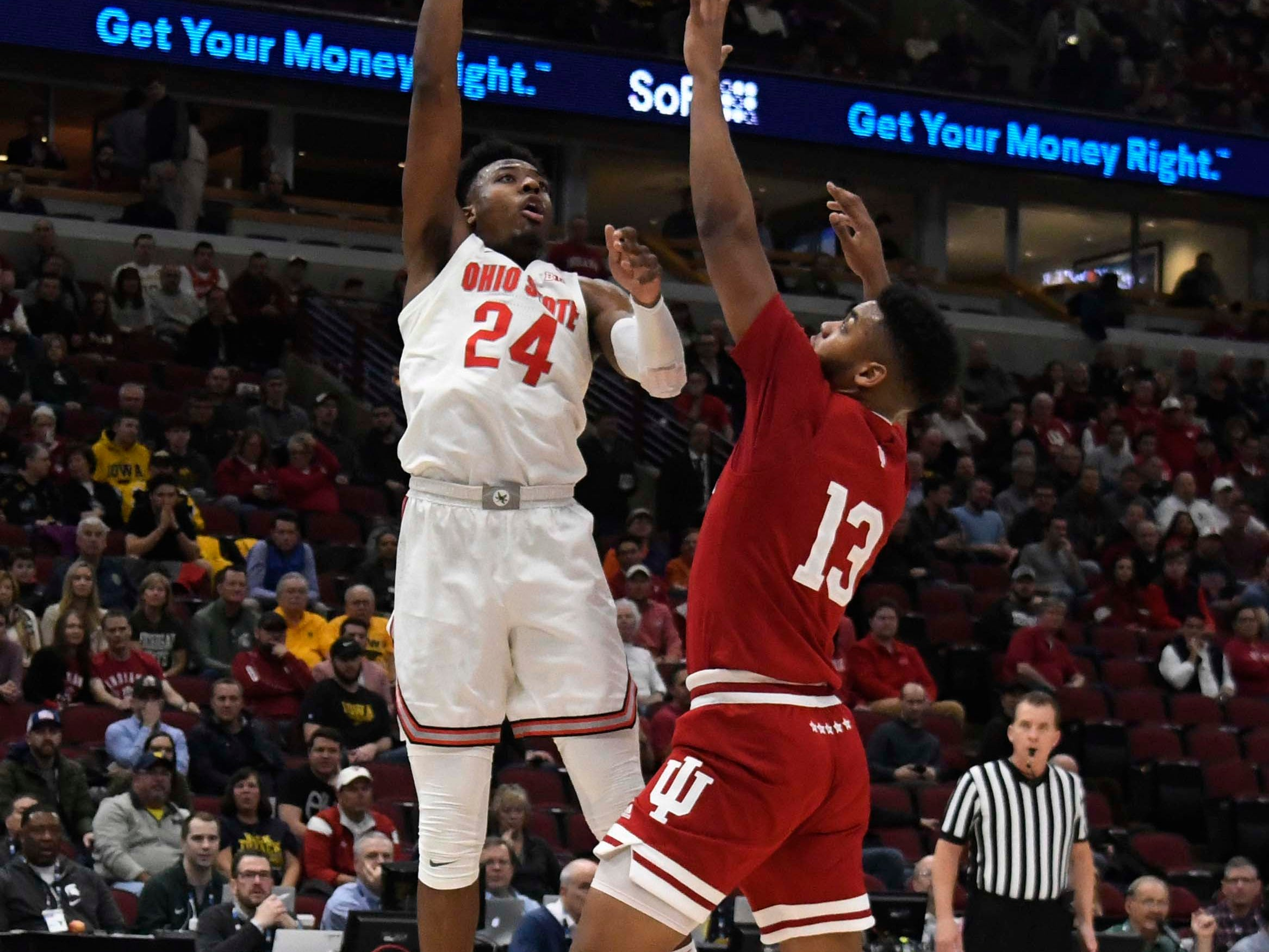 Mar 14, 2019; Chicago, IL, USA; Ohio State Buckeyes forward Andre Wesson (24) shoots over Indiana Hoosiers forward Juwan Morgan (13) during the first half in the Big Ten conference tournament at United Center. Mandatory Credit: David Banks-USA TODAY Sports