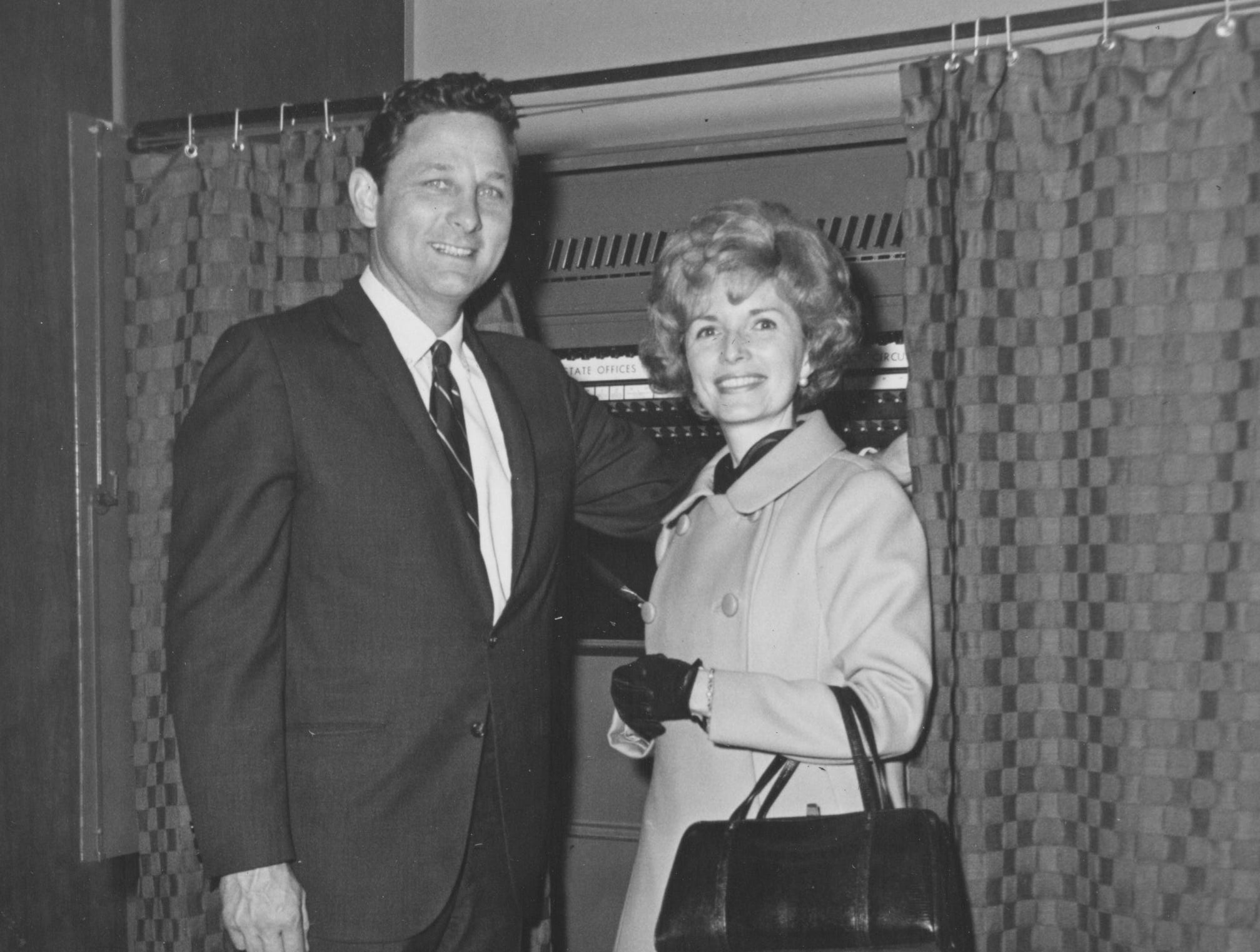 Indiana Senator Birch Bayh and wife, Marvella prepare to enter voting machine booth in Fayette Township, New Goshen, near the senators farm in Shirkieville Indiana. Senator and Mrs. Bayh motored to the West-central community early Tuesday morning from Indianapolis to cast their votes, later they return to the capitol city to await the outcome of the election. (11/05/1968)