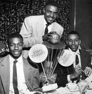 High school basketball stars from 1955: Oscar Robertson, Willie Hampton and Willie Merriweather of Crispus Attucks .