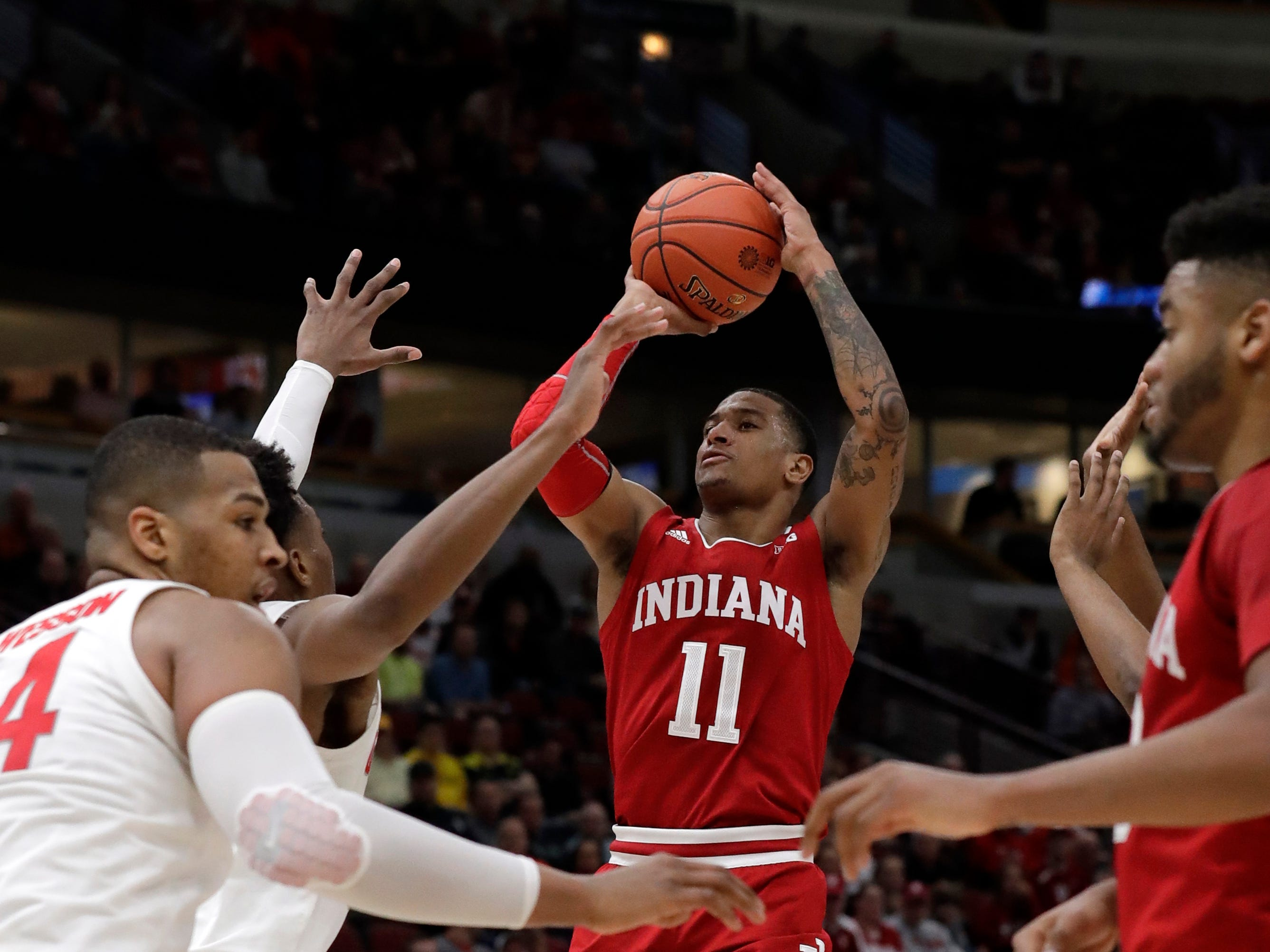 Indiana's Devonte Green (11) shoots during the first half of an NCAA college basketball game against the Ohio State in the second round of the Big Ten Conference tournament, Thursday, March 14, 2019, in Chicago. (AP Photo/Nam Y. Huh)