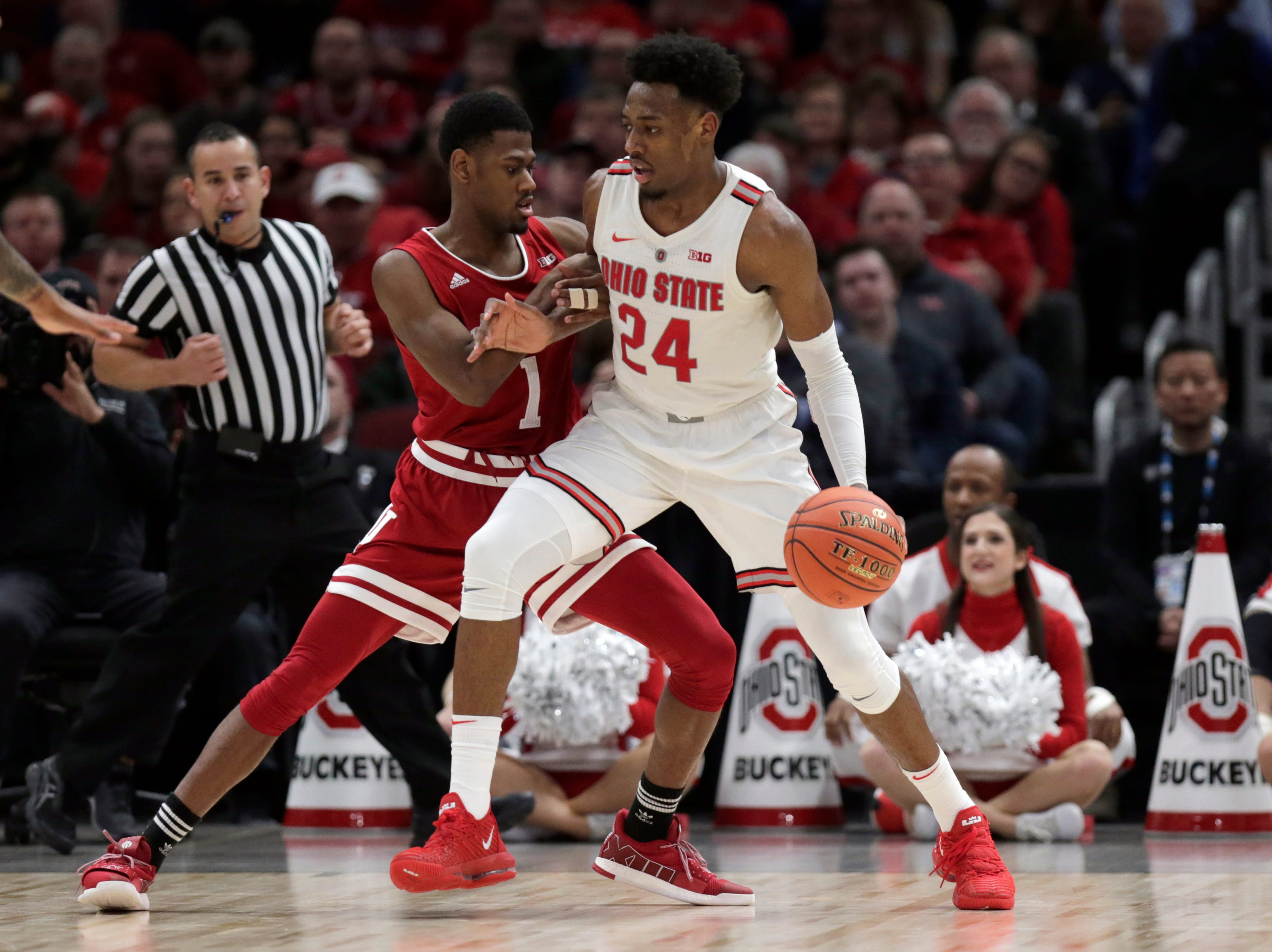 Ohio State's Andre Wesson (24) drives against Indiana's Aljami Durham (1) during the second half of an NCAA college basketball game in the second round of the Big Ten Conference tournament, Thursday, March 14, 2019, in Chicago. (AP Photo/Kiichiro Sato)