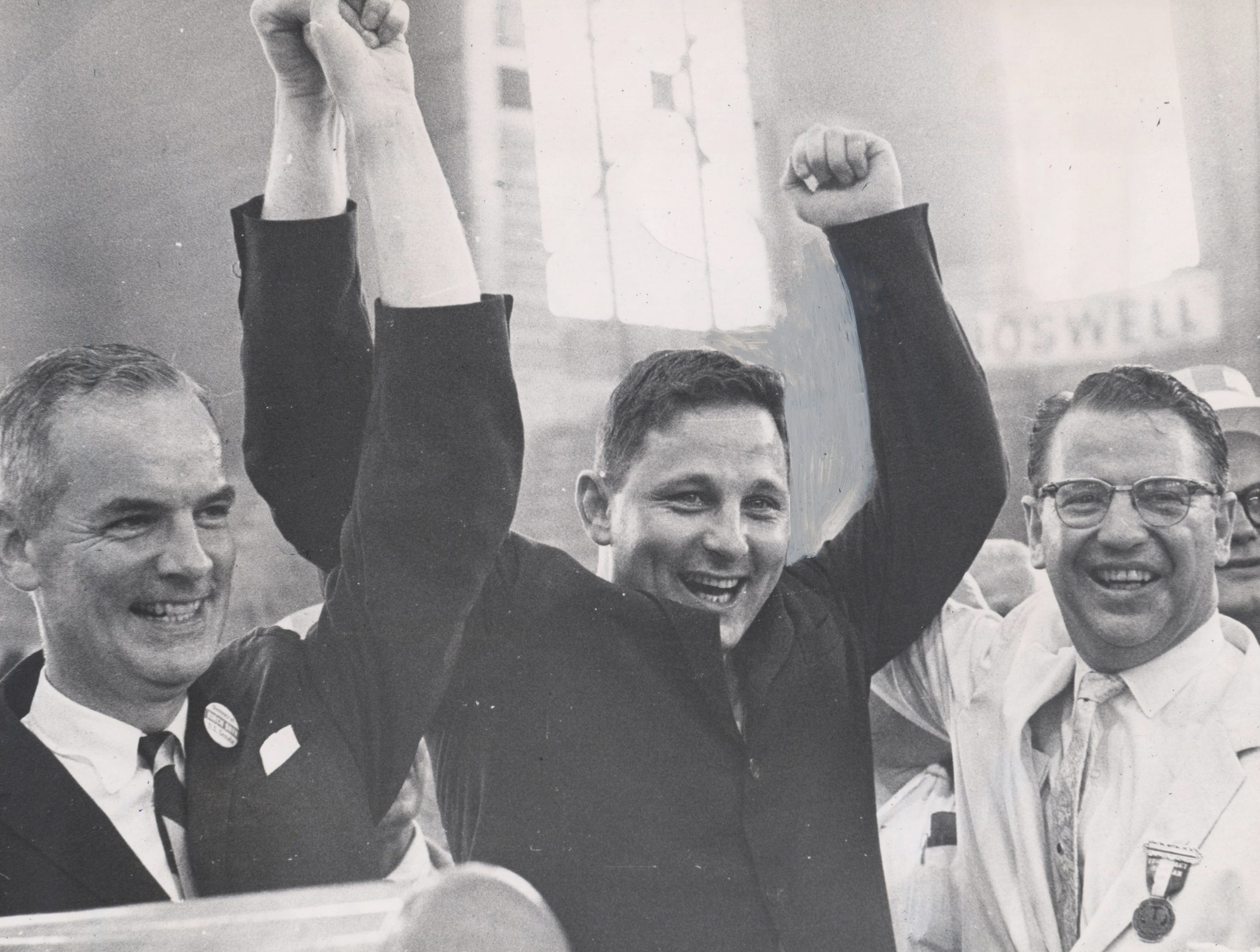Indianapolis-Indiana Governor Matthew Welsh, left and U.S. Senator Vance Hartke, right, hoist arms of Birch Bayh Jr. after he received U.S. nomination at the Democrat State Convention in Indianapolis (06/22/1962)