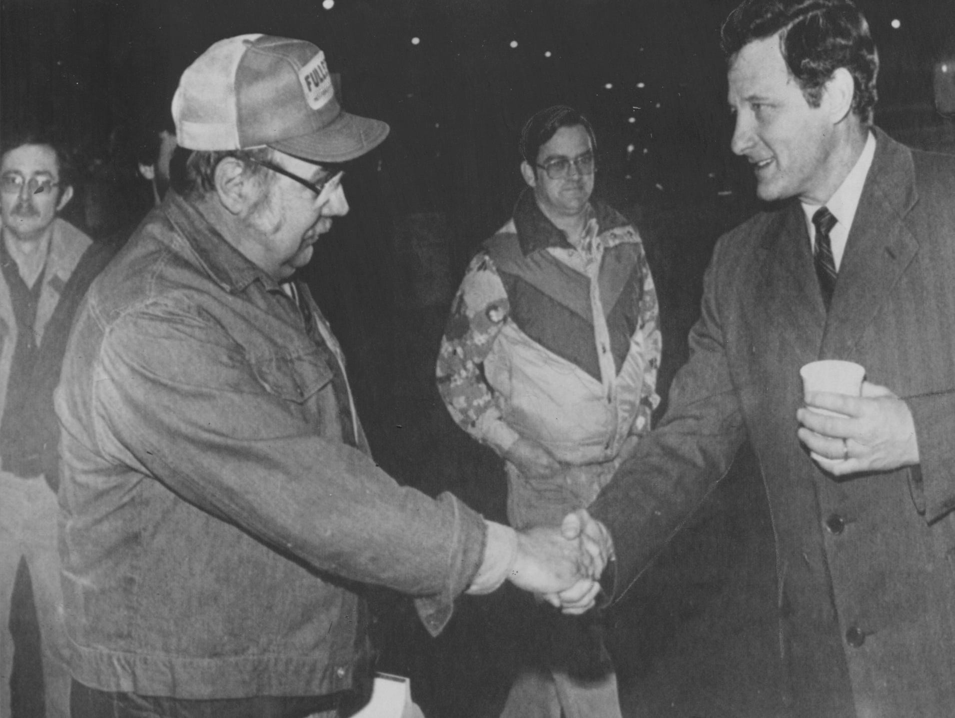 Sen. Birch Bayh, D-Ind., even in defeat, thanked workers at the Chevrolet plant in Indianapolis before sunrise Wednesday after losing to Republican Dan Quayle in his bid for an unprecedented fourth term in the U.S. Senate. After months of shaking hands at all hours of the day across he state Bayh and a dozen campaign workers want to just one more plant to thank the workers for their help. (11/5/1980)