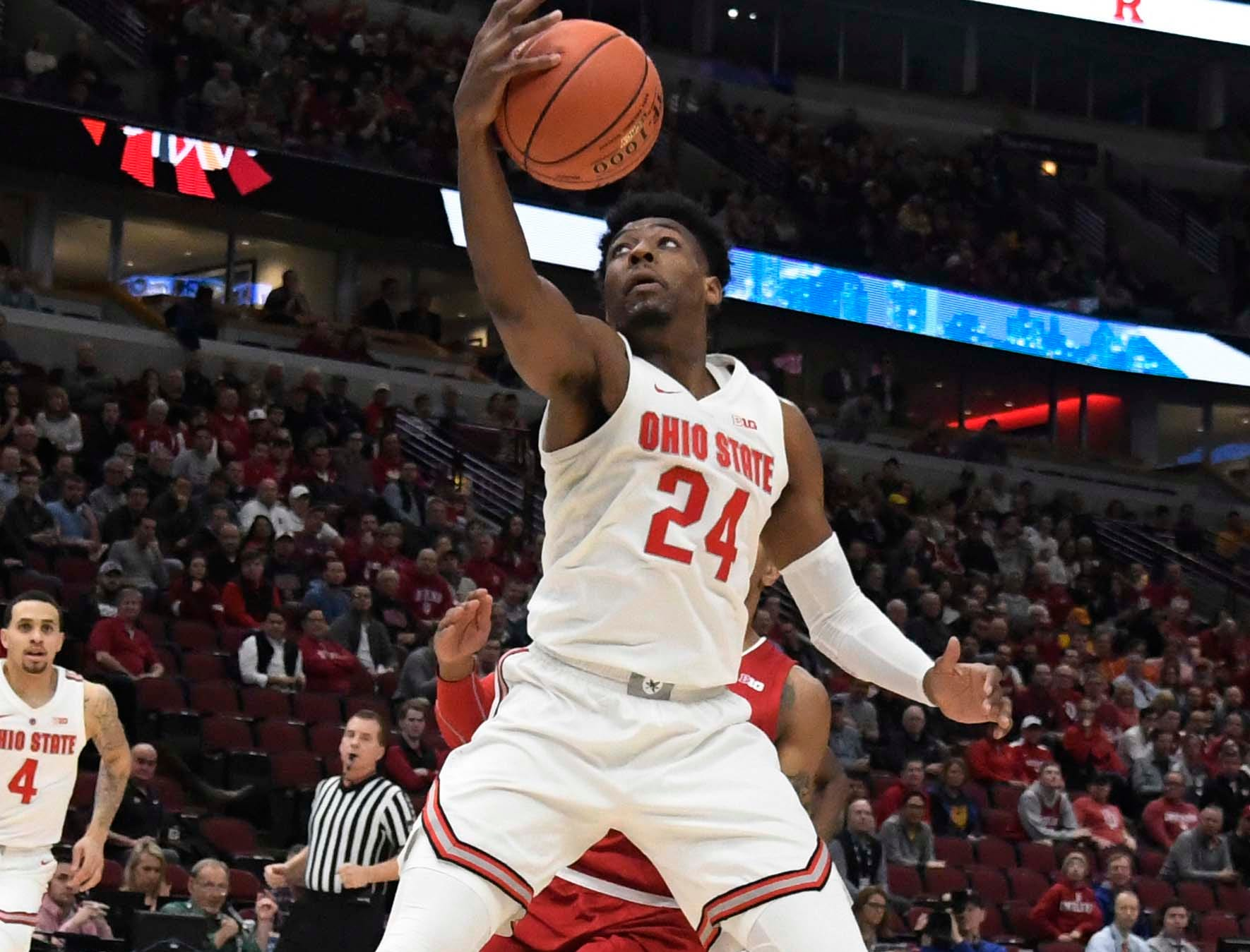 Mar 14, 2019; Chicago, IL, USA; Ohio State Buckeyes forward Andre Wesson (24) grabs a rebound against the Indiana Hoosiers during the first half in the Big Ten conference tournament at United Center. Mandatory Credit: David Banks-USA TODAY Sports