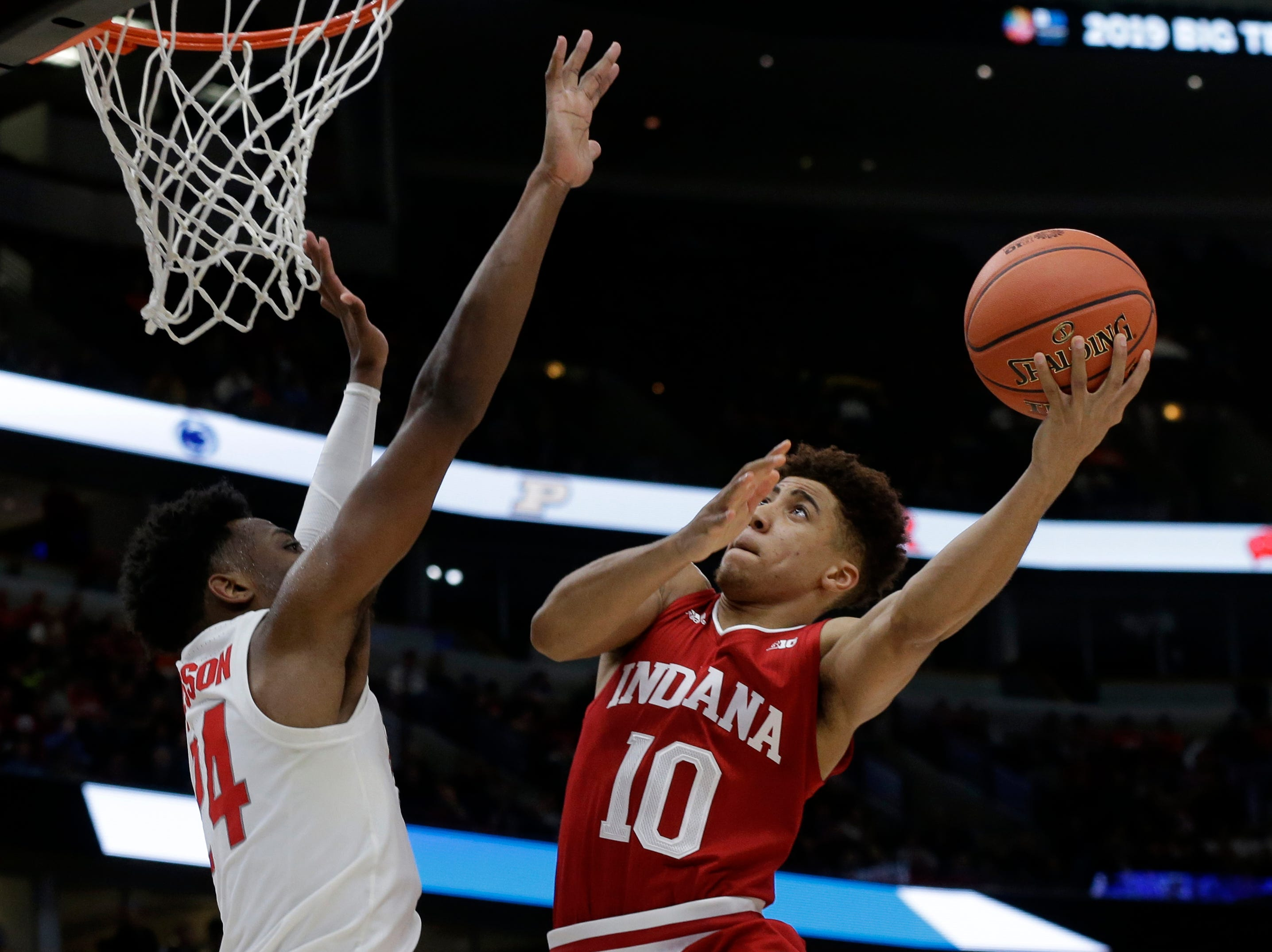 Indiana's Rob Phinisee (10) shoots against Ohio State's Andre Wesson (24) during the second half of an NCAA college basketball game in the second round of the Big Ten Conference tournament, Thursday, March 14, 2019, in Chicago. (AP Photo/Kiichiro Sato)
