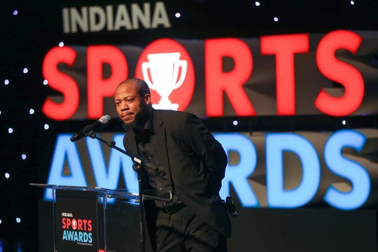 Crispus Attucks coach Chris Hawkins accepts the Team of the Year Award for Crispus Attucks basketball at the IndyStar Sports Awards at Clowes Memorial Hall, April 27, 2017.