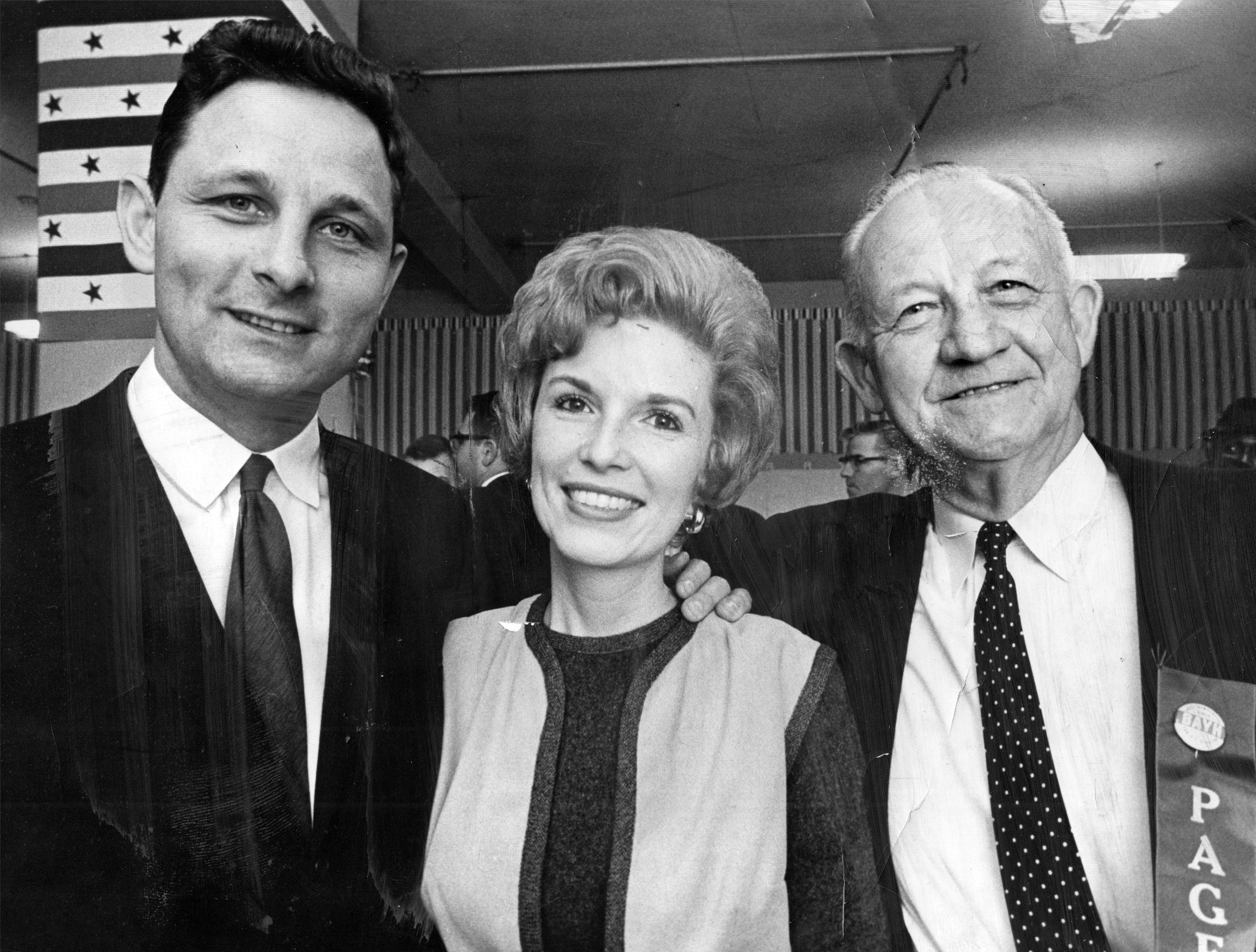 Birch Bayh Jr., left Democratic candidate for US senator, at campaign headquarters with his wife, Marvella, and his father Birch E. Bayh Sr on Nov. 7, 1962.