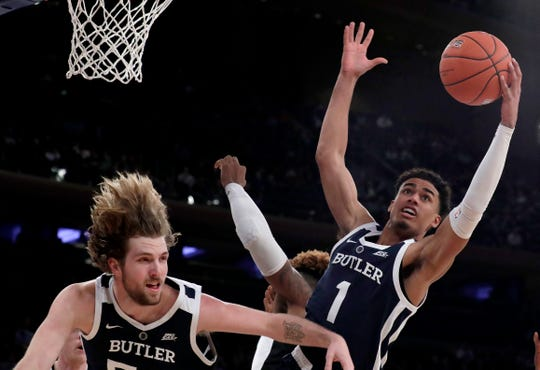 Butler forward Jordan Tucker (1) goes up for a rebound against Providence center Nate Watson, center, during the first half of an NCAA college basketball game in the Big East men's tournament, Wednesday, March 13, 2019, in New York. Butler's Joey Brunk is at left.