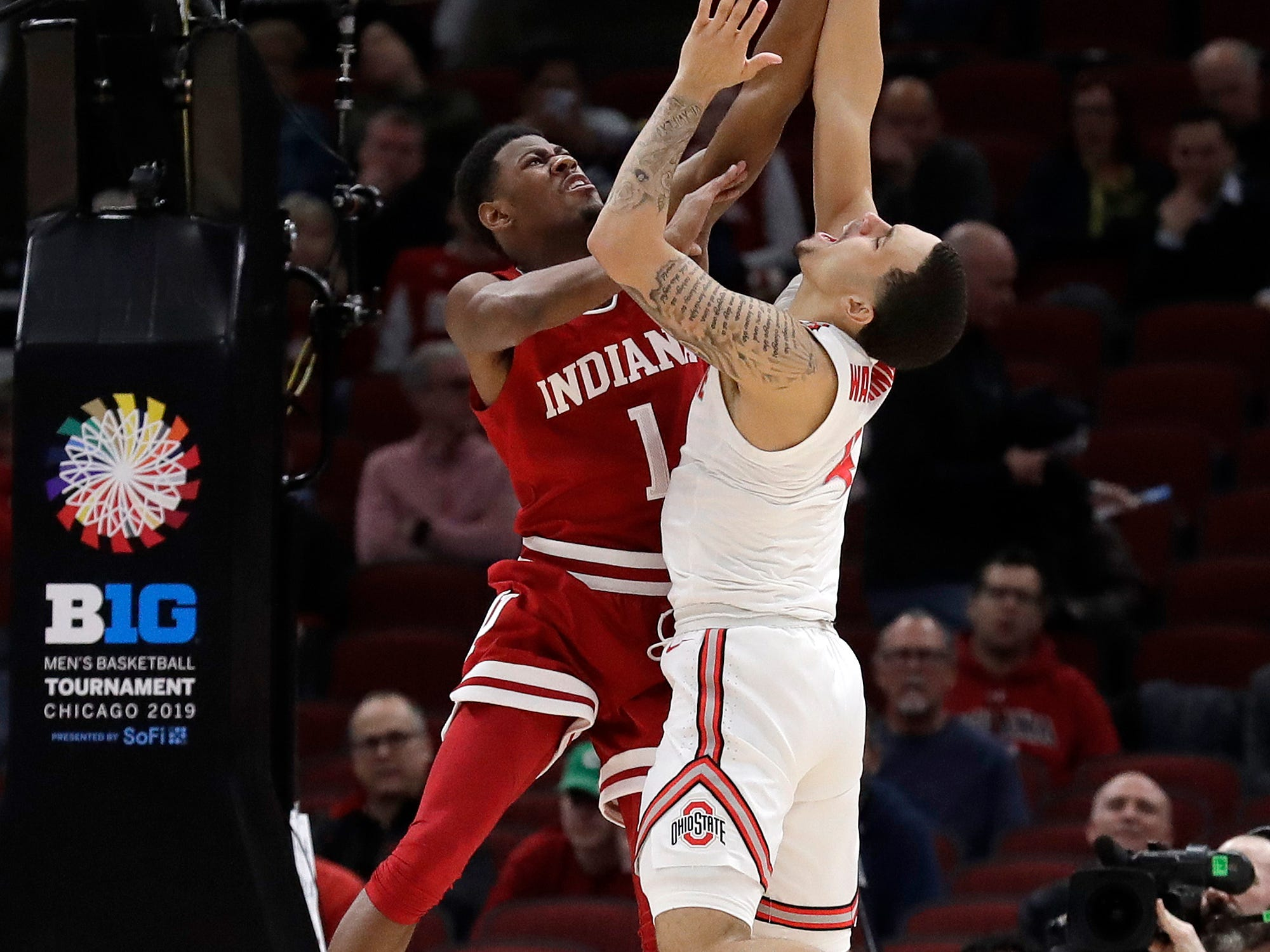 Indiana's Aljami Durham (1) blocks a shot by Ohio State's Duane Washington Jr. (4) during the first half of an NCAA college basketball game in the second round of the Big Ten Conference tournament, Thursday, March 14, 2019, in Chicago. (AP Photo/Nam Y. Huh)