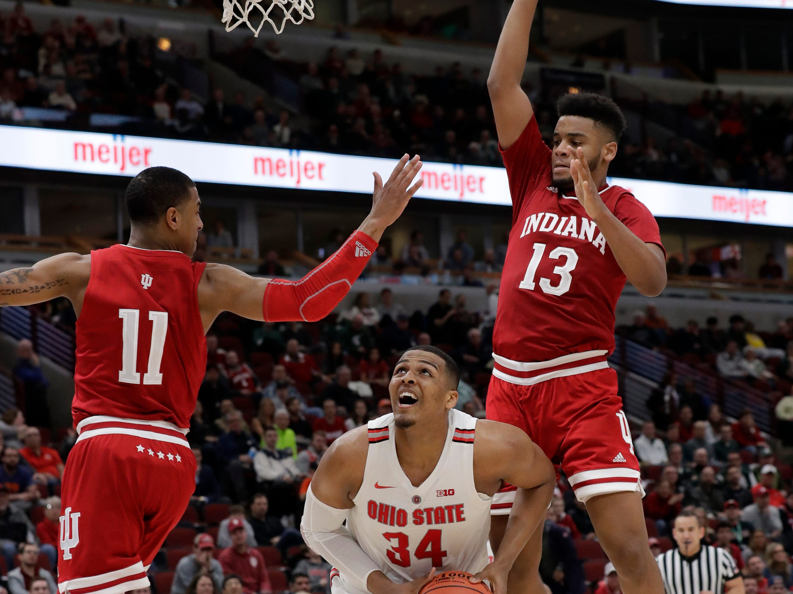 Ohio State's Kaleb Wesson (34) drives against Indiana's Devonte Green (11) and Juwan Morgan (13) during the second half of an NCAA college basketball game in the second round of the Big Ten Conference tournament, Thursday, March 14, 2019, in Chicago. (AP Photo/Nam Y. Huh)