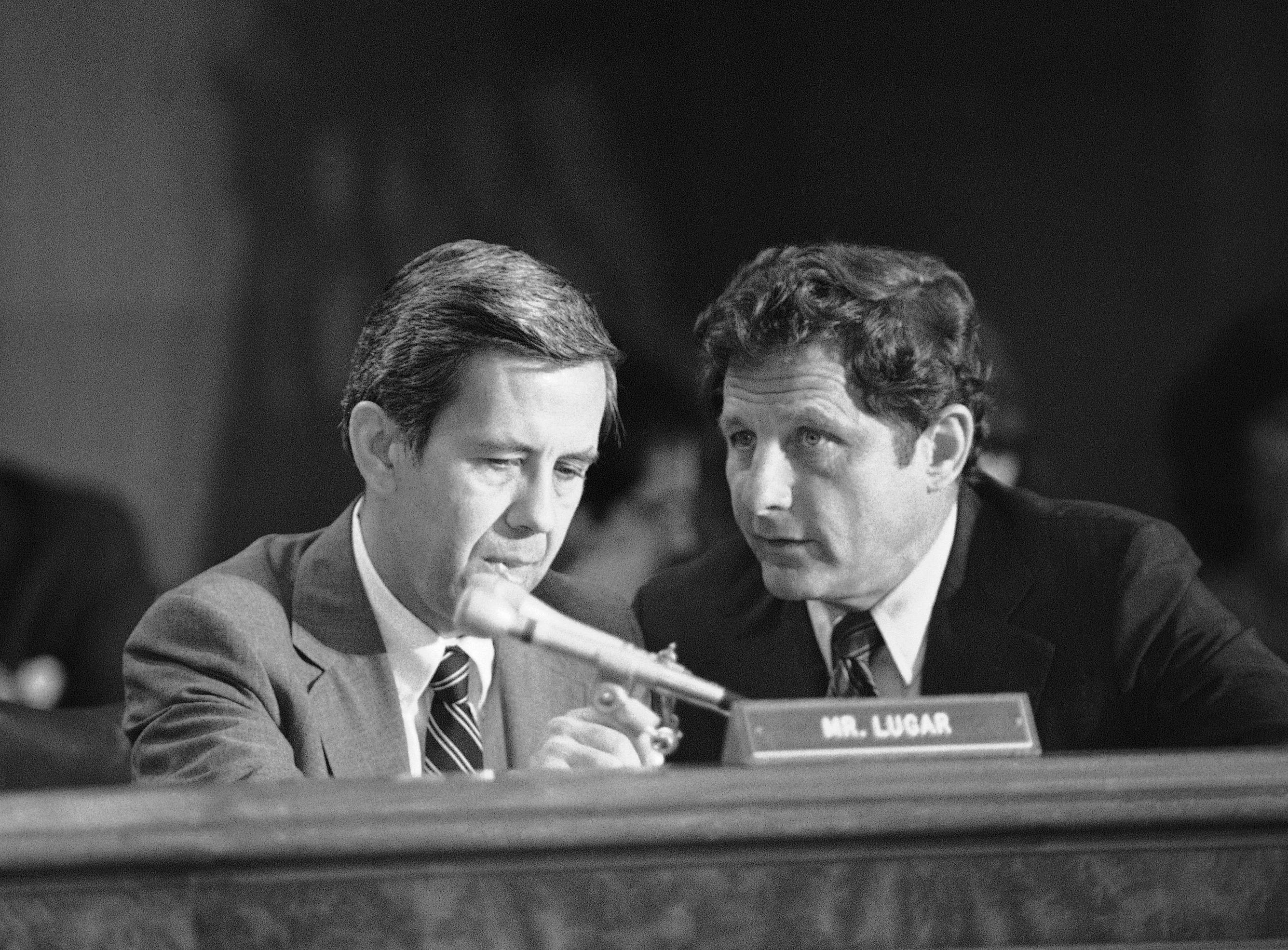 Sen. Richard Lugar, R-Ind., left, and Sen. Birch Bayh, D-Ind., chairman of the special Senate Judiciary subcommittee investigating individuals representing the interests of foreign governments, take a moment to plan strategy prior to the second day of hearings on Billy Carter?s relationship with the government of Libya on Capital Hill in Washington, Wednesday, August 21, 1980. (AP Photo/Harrity)