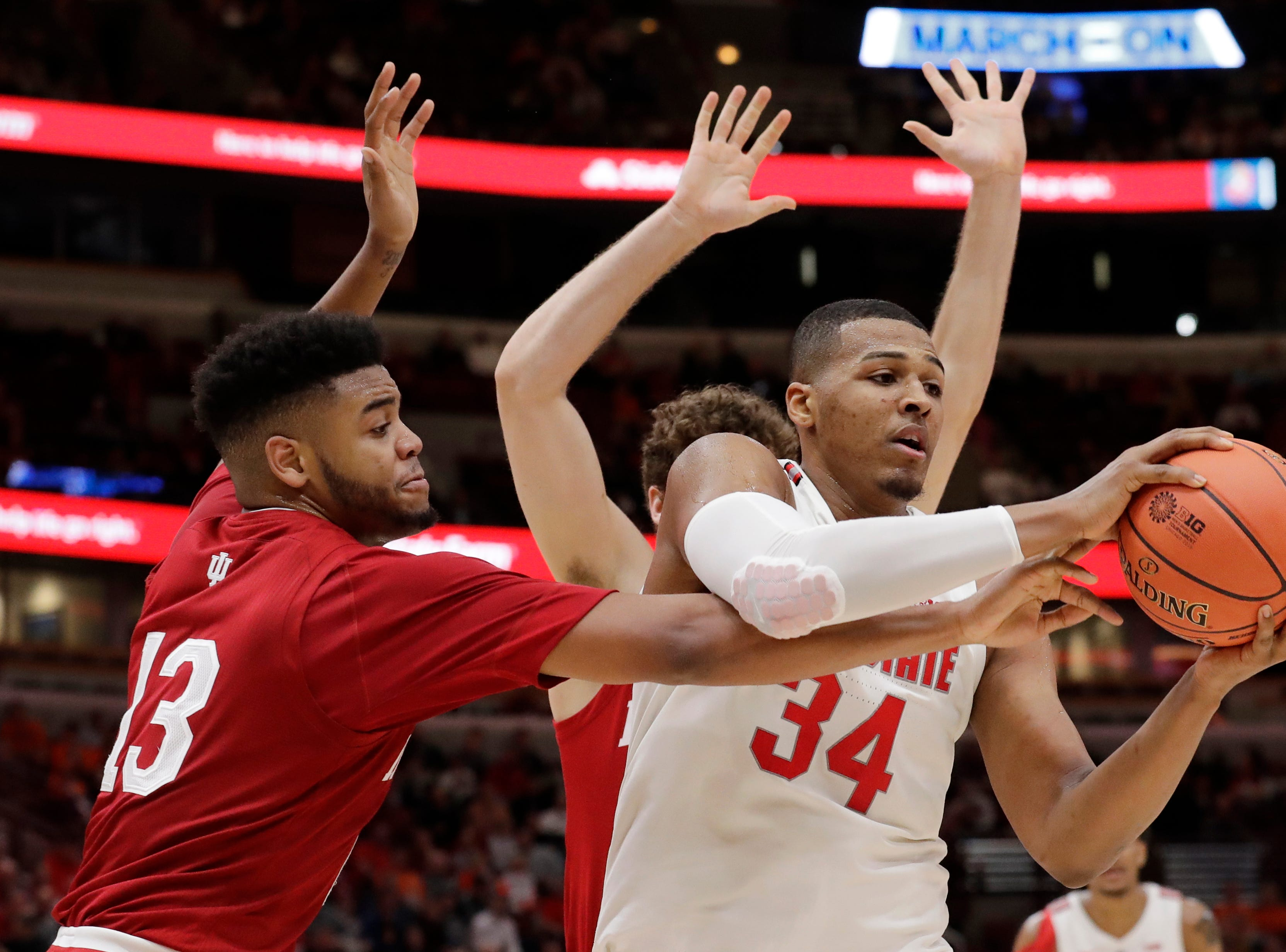 Ohio State's Kaleb Wesson (34) looks to pass against Indiana's Juwan Morgan (13) during the second half of an NCAA college basketball game in the second round of the Big Ten Conference tournament, Thursday, March 14, 2019, in Chicago. (AP Photo/Nam Y. Huh)