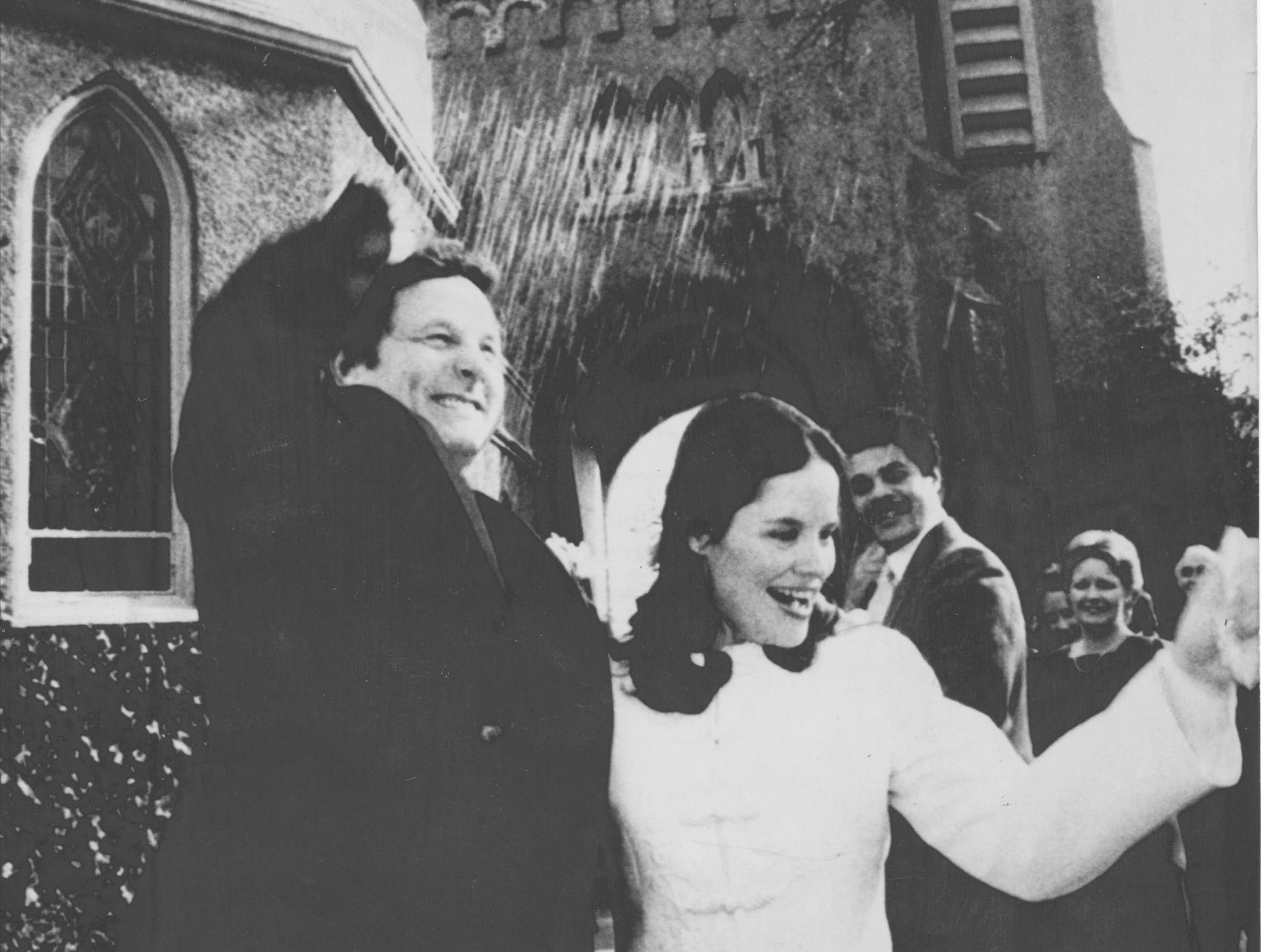 Washington-Former Indiana Senator Birch Bayh and his new bride Katherine Halpin, director of news information at ABC, hurry to avoid rice as they leave St. Alban's Chapel at the National Cathedral in Washington Thursday shortly after they were married. (12/24/1981)