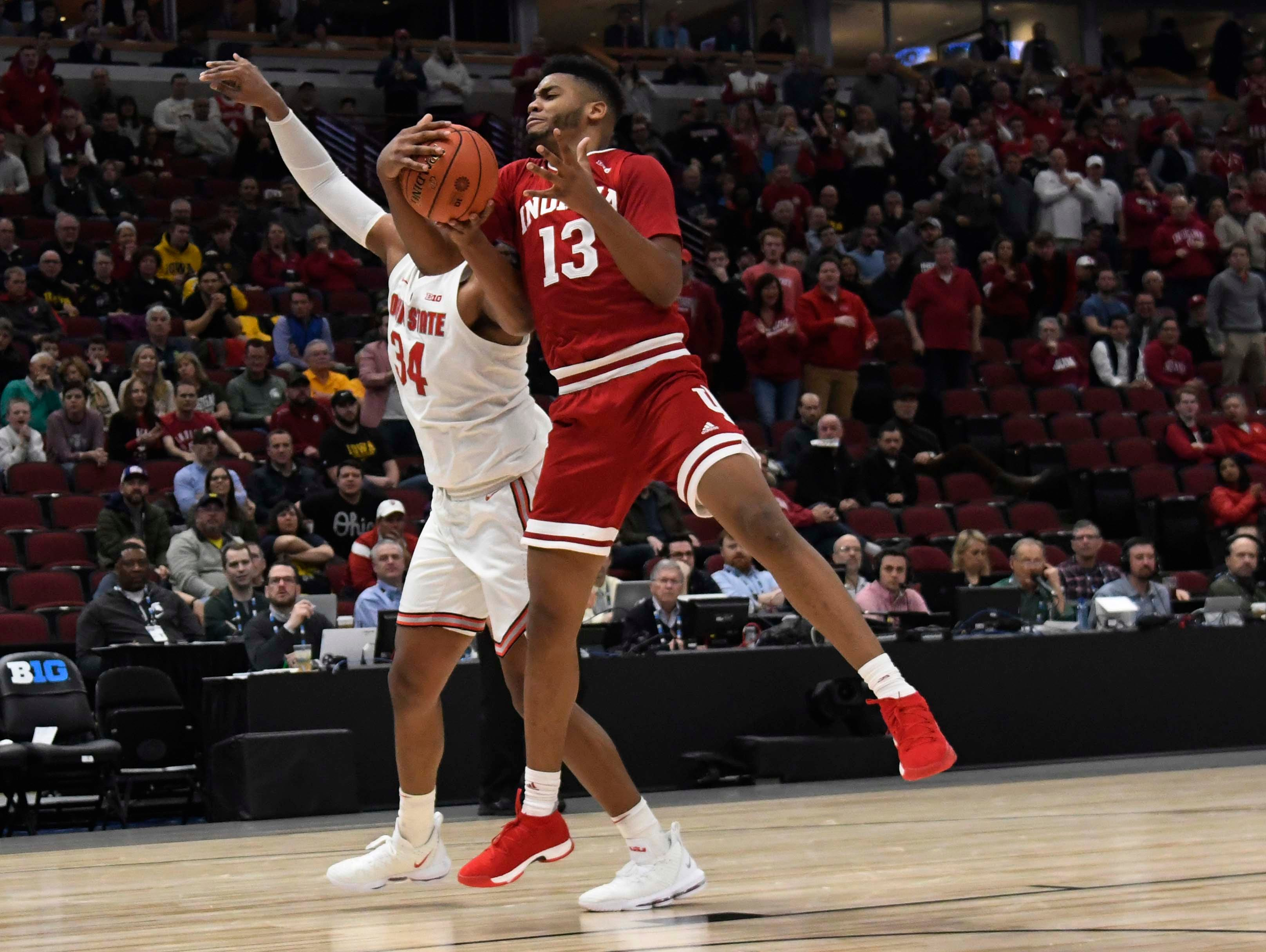Mar 14, 2019; Chicago, IL, USA; Indiana Hoosiers forward Juwan Morgan (13) and Ohio State Buckeyes forward Kaleb Wesson (34) go for a rebound during the first half in the Big Ten conference tournament at United Center. Mandatory Credit: David Banks-USA TODAY Sports
