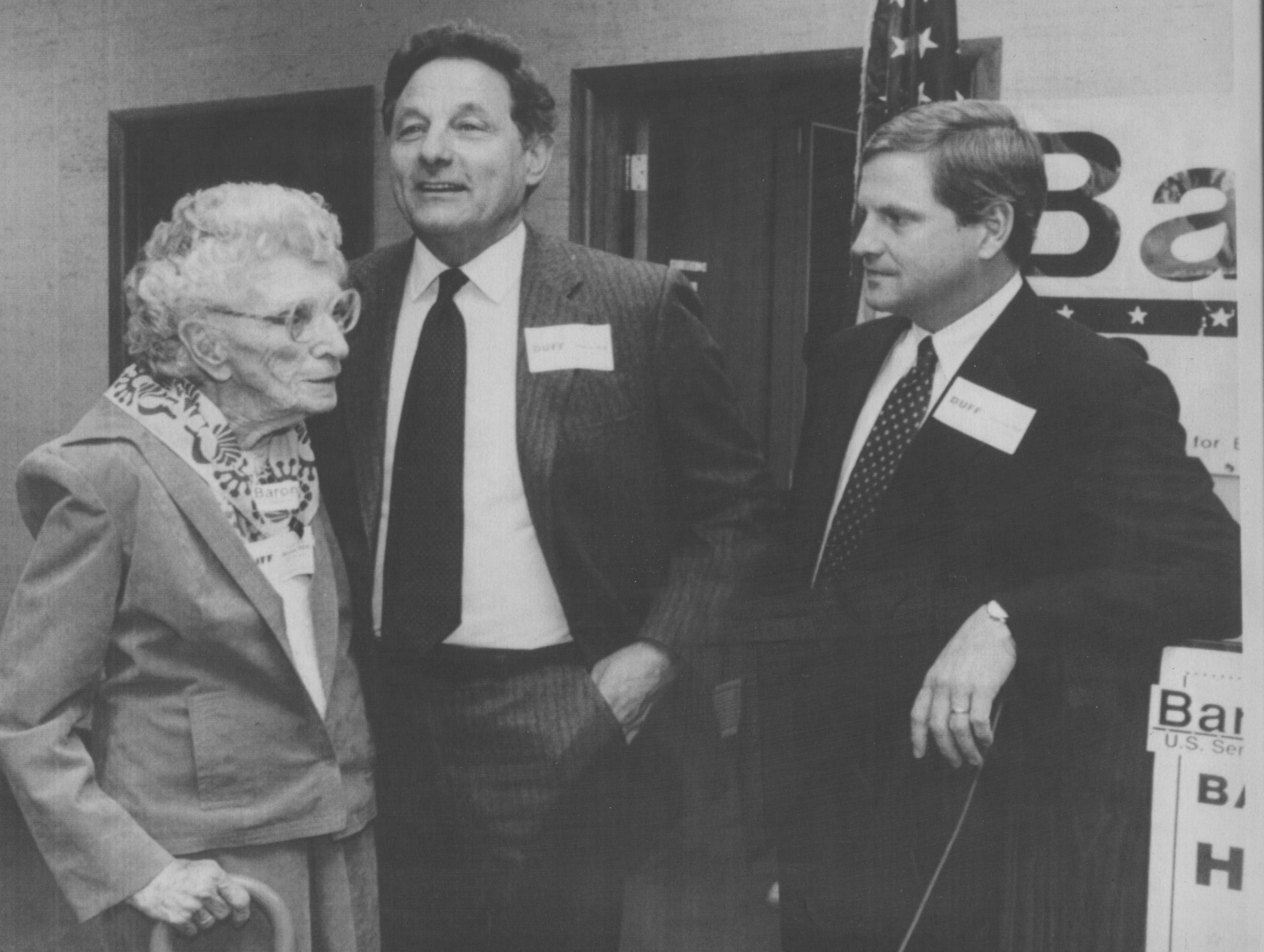 Indianapolis-Former Sen. Birch Bayh, D-Ind., (center) campaigns for Democratic senatorial candidate Baron Hill as they meet Agnes Shepard, 99, of Linton, Ind., at a rally in Indianapolis Monday. Hill is running against Republican incumbent Dan Coats. (11/5/1990)