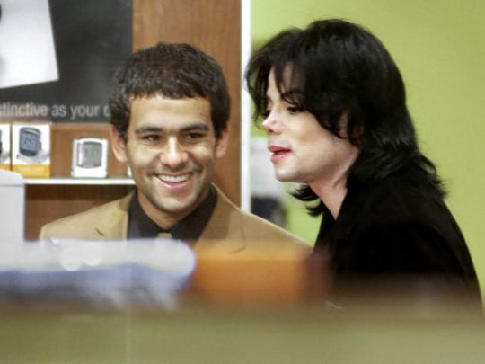 Michael Jackson, right, visited a Brookstone store in Circle Centre mall during a 2003 visit to Indianapolis.