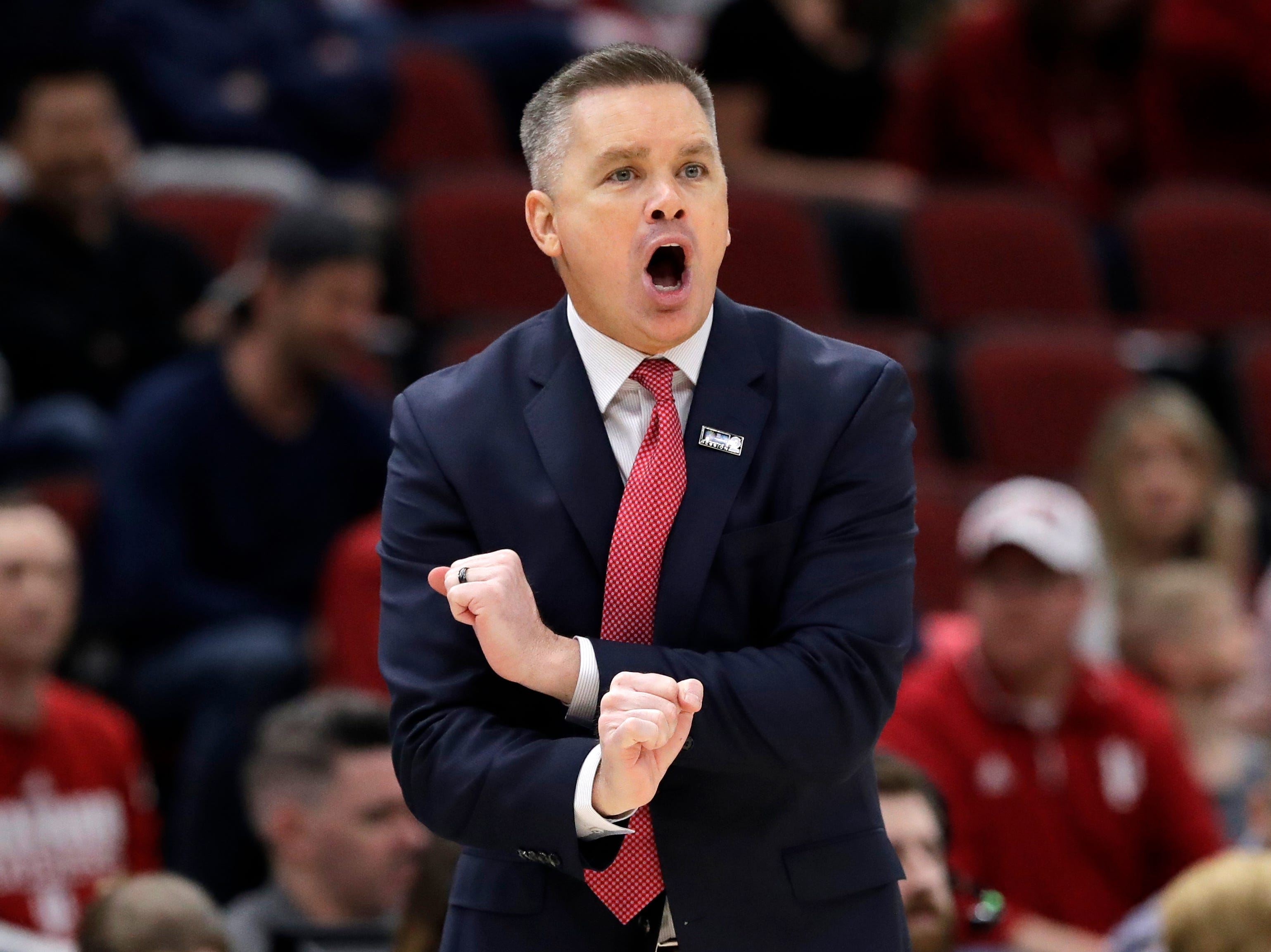 Ohio State head coach Chris Holtmann directs his team during the first half of an NCAA college basketball game against the Indiana in the second round of the Big Ten Conference tournament, Thursday, March 14, 2019, in Chicago. (AP Photo/Nam Y. Huh)