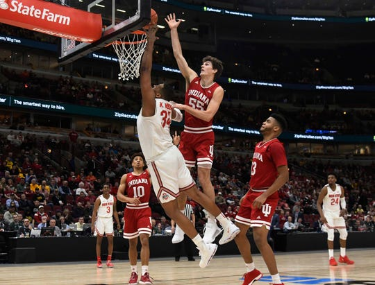 Mar 14, 2019; Chicago, IL, USA; Indiana Hoosiers forward Evan Fitzner (55) defends Ohio State Buckeyes forward Kaleb Wesson (34) during the first half in the Big Ten conference tournament at United Center. Mandatory Credit: David Banks-USA TODAY Sports