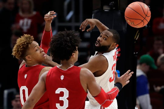 Ohio State's Keyshawn Woods (32) passes the ball against Indiana's Romeo Langford (0) and Justin Smith (3) in the second round of the Big Ten tournament, Thursday, in Chicago.