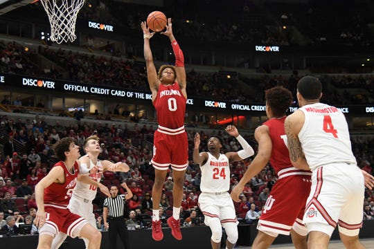 Mar 14, 2019; Chicago, IL, USA; Indiana Hoosiers guard Romeo Langford (0) grabs a rebound against the Ohio State Buckeyes during the first half in the Big Ten conference tournament at United Center. Mandatory Credit: David Banks-USA TODAY Sports
