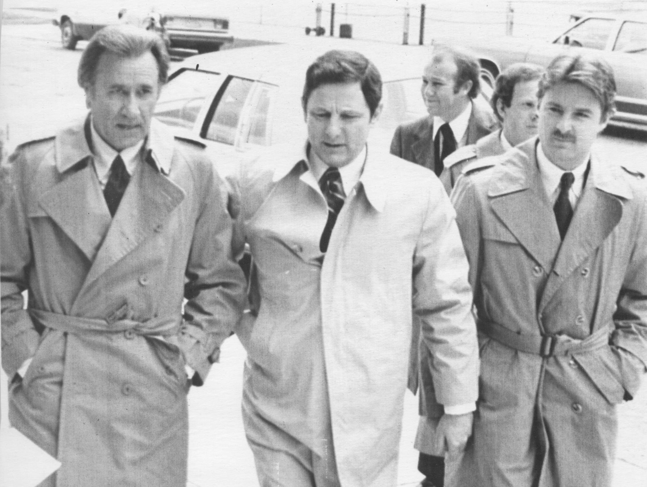 Terre Haute, IN: United States Senator Birch Bayh (center), (D-Ind.) flanked by the Rev. Oral Roberts (L) and Bayh's son, Evan, makes his way into a church 4/27 for memorial services for his wife, Marvella who died earlier this week of cancer. Mrs. Bayh, 46, died 4/24 in Bethseda, Md., after an 8-year bout with the disease. Rev. Roberts was one of several local, state and national figures attending and speaking at the services. (04/27/1979)