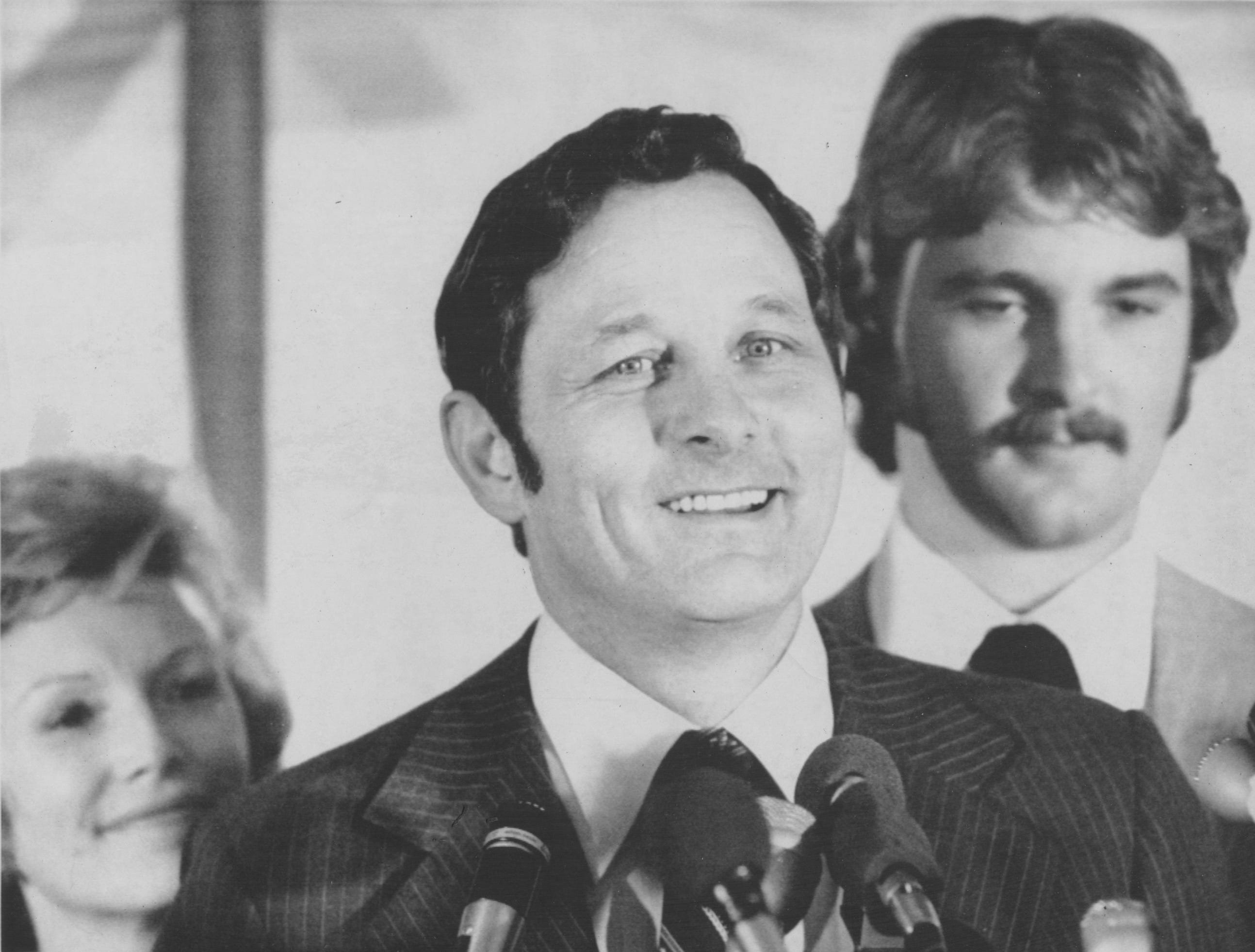 Shirkieville, Ind., Indiana junior Sen. Birch Bayh at a rally on Oct. 21, 1975 with friends on his boyhood farm tells the more than 600 supporters that he will seek the Democratic presidential nomination. With Bayh are his wife, Marvella (left) and son, Evan. Bayh later made the formal announcement in the Indiana House chambers. The third-term senator is the ninth declared candidate.
