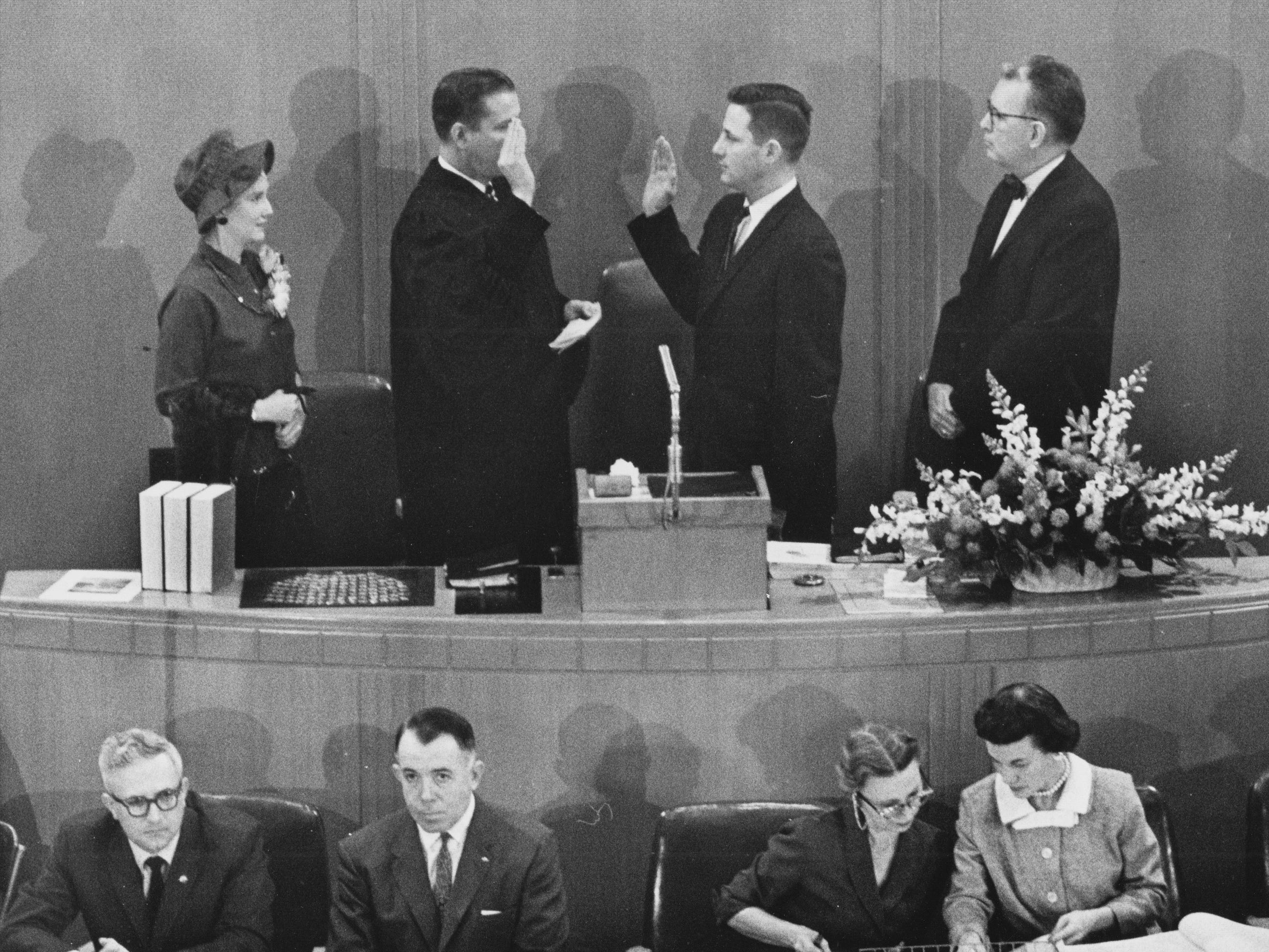 Birch Bayh is sworn in as Speaker of the Indiana House of Representatives on Jan. 8, 1959 as wife Marvella looks on.