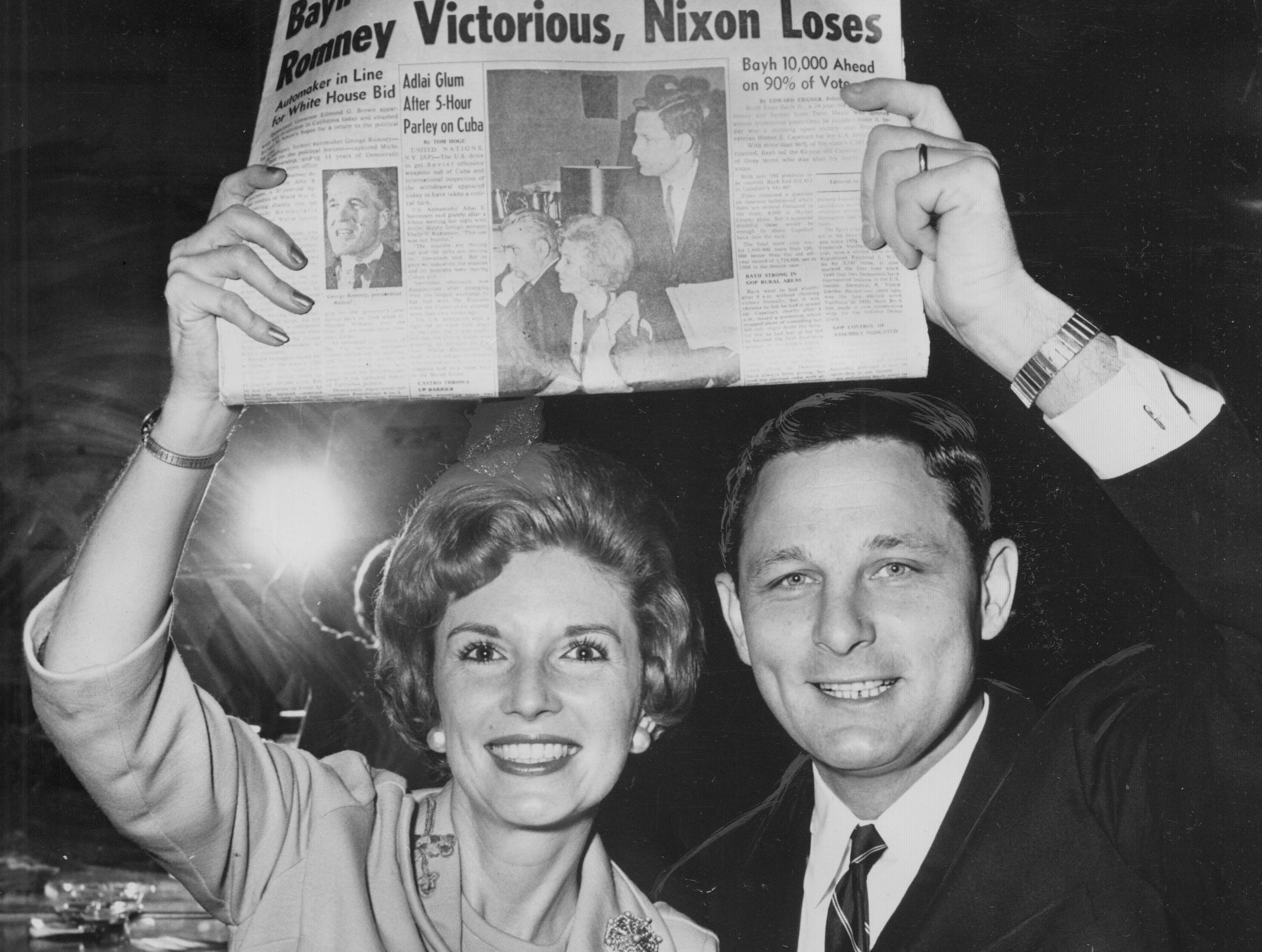 Senator-elect Birch Bayh Jr. and his wife, Marvella hoist a first edition of The News proclaiming his narrow victory over incumbent Republican Homer E. Capehart on Nov. 7, 1962,