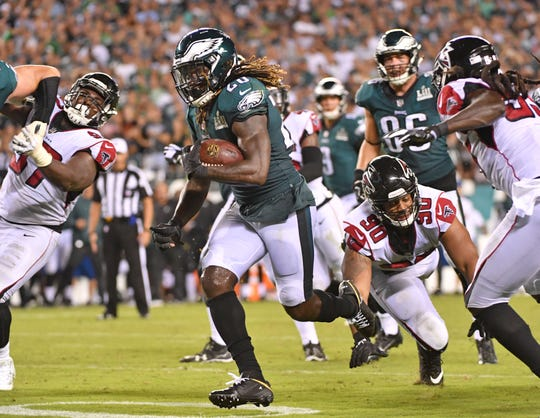 Sep 6, 2018; Philadelphia, PA, USA; Philadelphia Eagles running back Jay Ajayi (26) scores on a 11-yard touchdown  run against the Atlanta Falcons during the fourth quarter at Lincoln Financial Field.