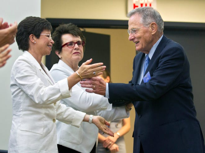 Valerie Jarrett, chair of the Council on Women and Girls, and tennis great Billie Jean King applaud former Indiana Sen. Birch Bayh in 2012.
