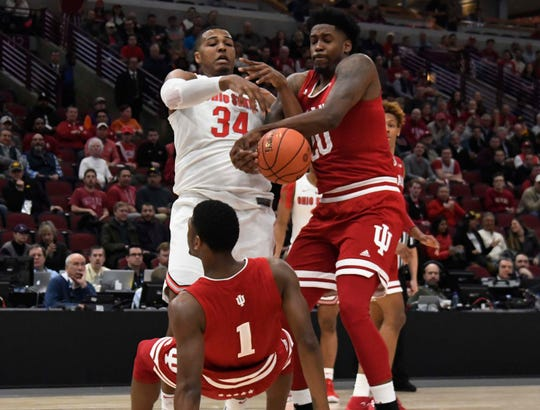 Mar 14, 2019; Chicago, IL, USA; Ohio State Buckeyes forward Kaleb Wesson (34) Indiana Hoosiers forward De'Ron Davis (20) and guard Aljami Durham (1) go for the ball during the first half in the Big Ten conference tournament at United Center. Mandatory Credit: David Banks-USA TODAY Sports