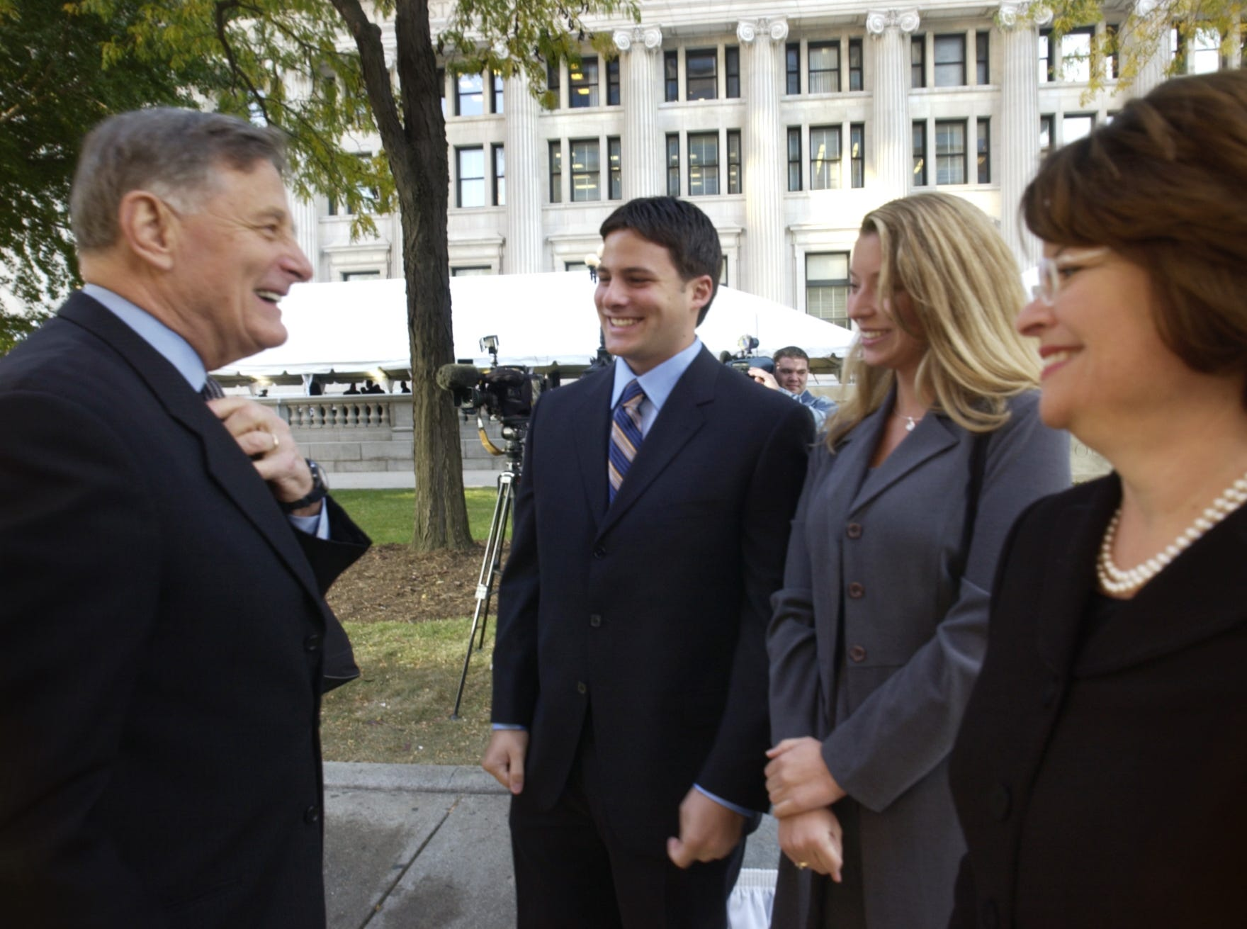 Birch Bayh attended a ceremony at the federal courthouse in 2003 in which the 100-year-old building on Ohio Street was renamed as Birch Bayh Federal Building and United States Courthouse.  IN THIS PHOTO:  Birch Bayh (left) talks with his wife Kitty Bayh (right), their son Chris Bayh (second from left) and Chris' friend Erin Thomas (second from right) after they arrived at the courthouse this morning before the renaming ceremony.