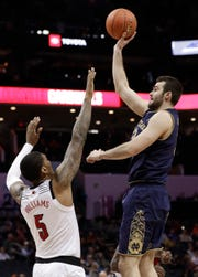 Notre Dame's John Mooney, right, shoots against Louisville's Malik Williams (5) during the first half of an NCAA college basketball game in the Atlantic Coast Conference tournament in Charlotte, N.C., Wednesday, March 13, 2019.
