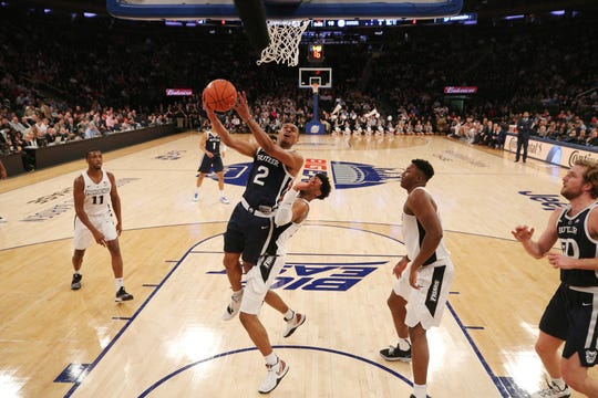 Mar 13, 2019; New York, NY, USA; Butler Bulldogs guard Aaron Thompson (2) drives to the basket against Providence Friars guard A.J. Reeves (10) during the first half of a first round game of the Big East conference tournament at Madison Square Garden.