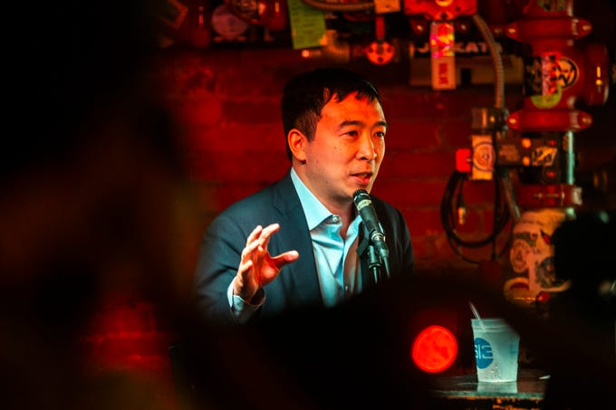 "2020 presidential candidate Andrew Yang, of New York, speaks while a guest on the ""Political Party Live!"" live recording on Wednesday, March 13, 2019, at the Yacht Club bar in Iowa City, Iowa."