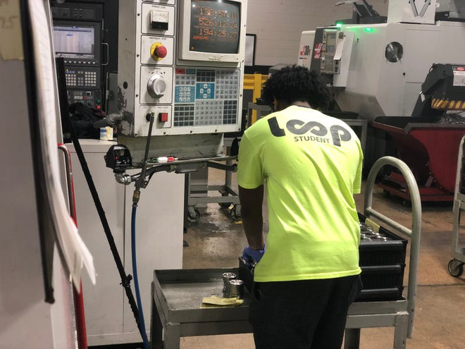 Cameron Walker, a senior at North Side High School, works at Stanley Black & Decker through L.O.O.P., Local Options and Opportunities Program.