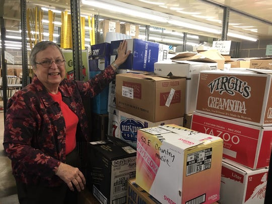 Mary Ellen Smethells shows off one of many bays full of already-sorted books, ready to be moved into the Jacob Building at Chilhowee Park at the end of the month. Boxes are numbered according to category.