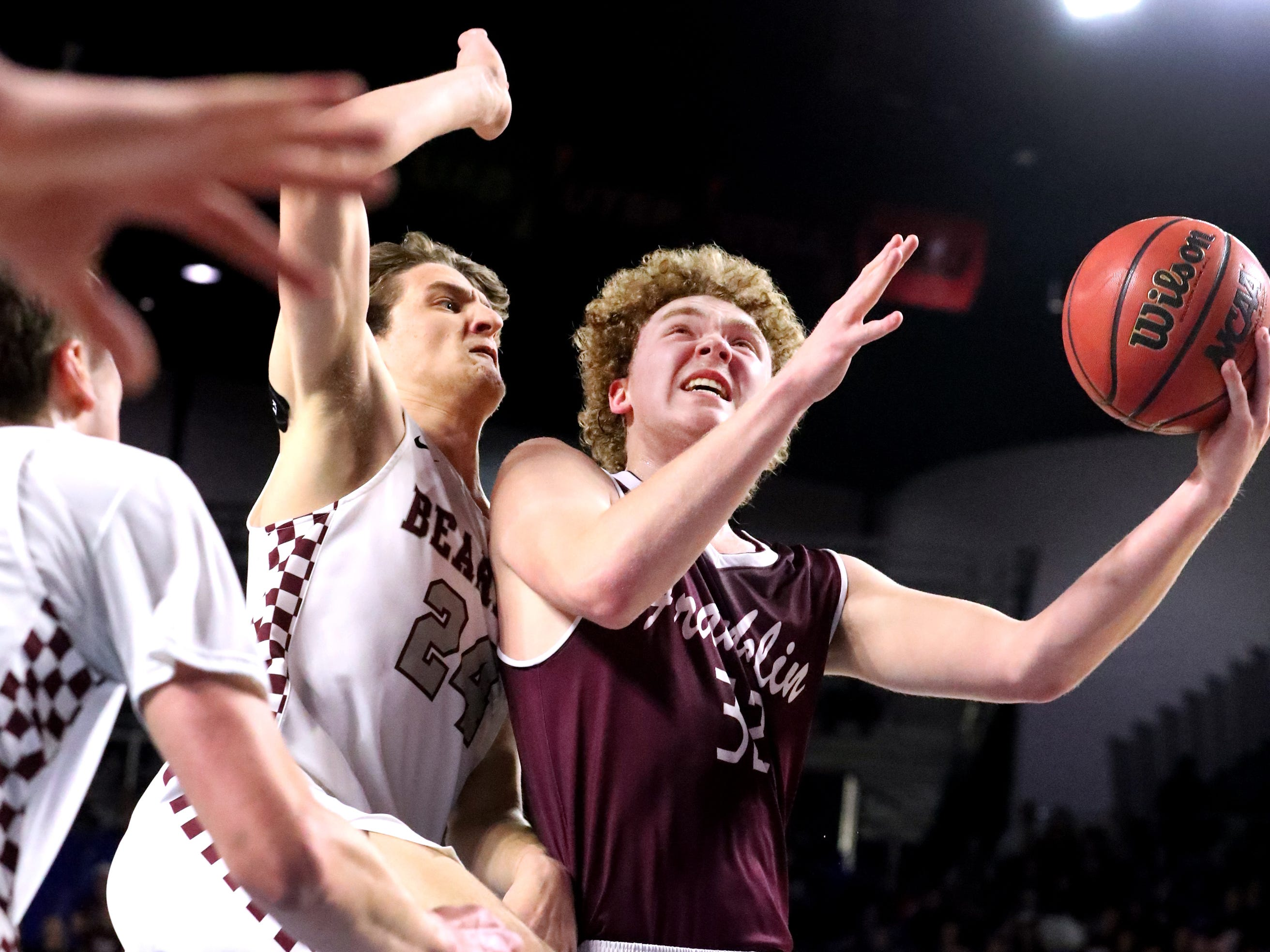 Franklin's Matthew Thurman (32) goes up for a shot as Bearden's Kordell Kah (24) guards him during the quarterfinal round of the TSSAA Class AAA Boys State Tournament, on Wednesday, March 13, 2019, at Murphy Center in Murfreesboro, Tenn.