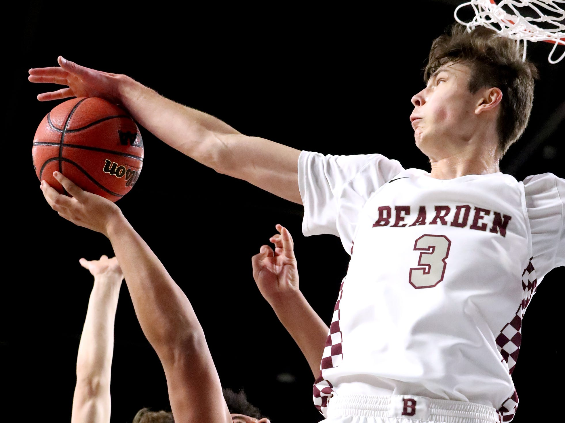 Franklin's Ahsharri Haynesworth (2) goes up for a shot as Bearden's Drew Pember (3) blocks it and Bearden's Kordell Kah (24) guards him from behind during the quarterfinal round of the TSSAA Class AAA Boys State Tournament, on Wednesday, March 13, 2019, at Murphy Center in Murfreesboro, Tenn.