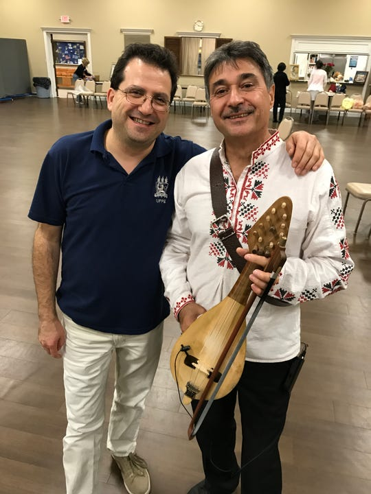 """Hristov with a fellow musician - a gadulka player - from the Bulgarian band """"Kabile,"""" at a concert at St. George Greek Orthodox Church in Knoxville. Nov. 16, 2017."""