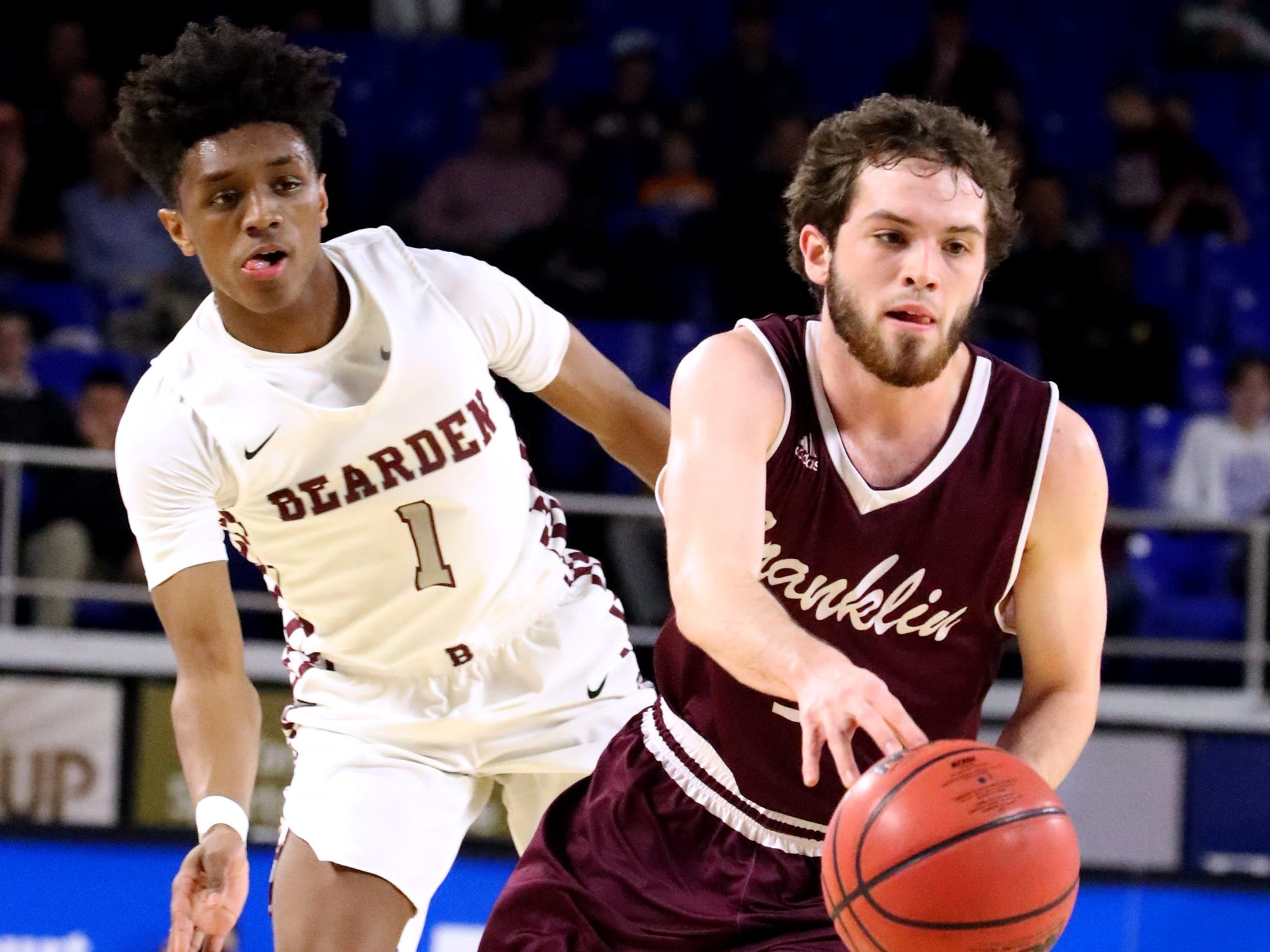 Franklin's Reese Glover (3) moves around Bearden's Trent Stephney (1) during the quarterfinal round of the TSSAA Class AAA Boys State Tournament, on Wednesday, March 13, 2019, at Murphy Center in Murfreesboro, Tenn.