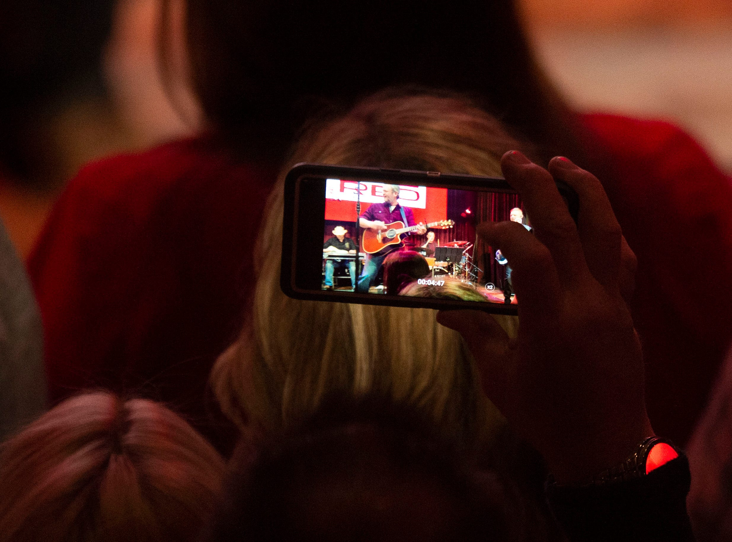 A fan documents the Blake Shelton performance at the grand opening of Ole Red Gatlinburg on Wednesday, March 13, 2019.