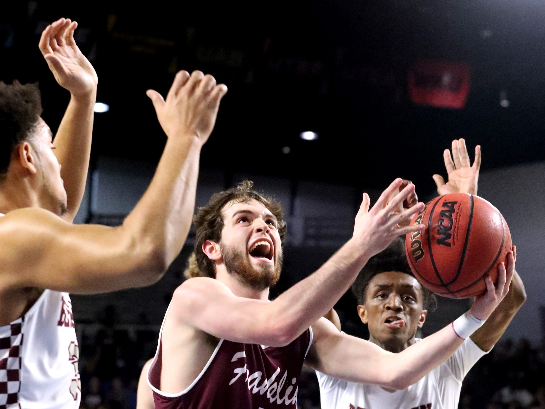 Franklin's Reese Glover (3) shoots between Bearden's Shamarcus Brown (35) and Bearden's Trent Stephney (1) during the quarterfinal round of the TSSAA Class AAA Boys State Tournament, on Wednesday, March 13, 2019, at Murphy Center in Murfreesboro, Tenn.