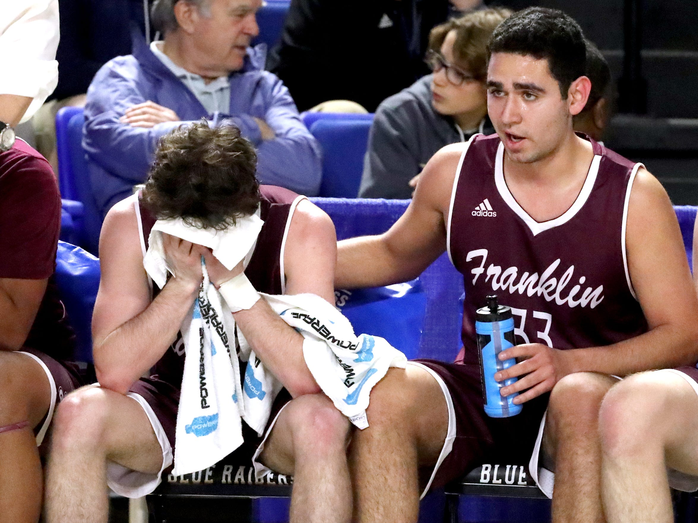 Franklin High School seniors Franklin's Luis Sanchez (33), right, comforts Reese Glover (3),left as they react to losing during the final moments in the quarterfinal round of the TSSAA Class AAA Boys State Tournament against Bearden, on Wednesday, March 13, 2019, at Murphy Center in Murfreesboro, Tenn.