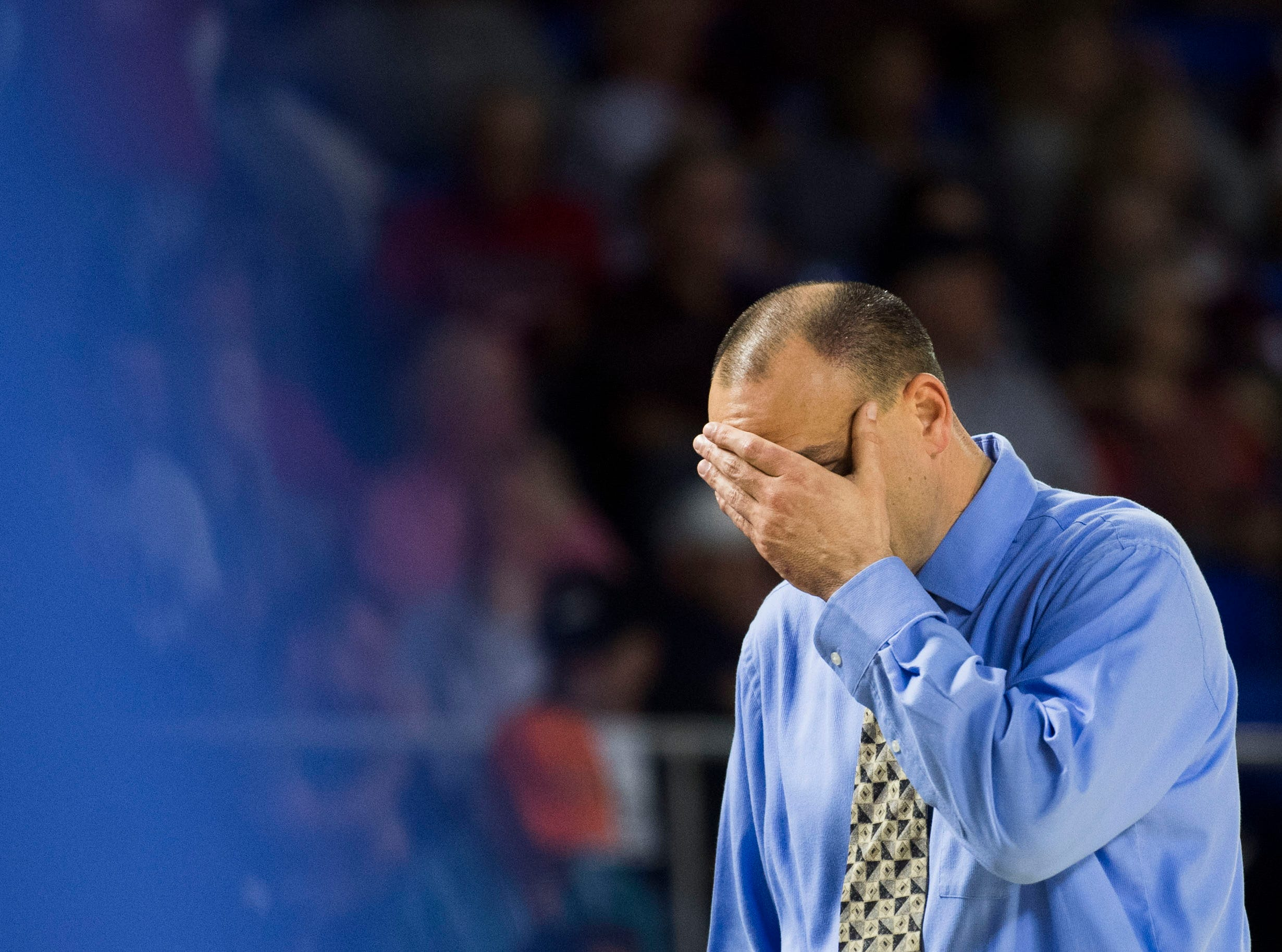 Cosby's head coach Brad Flatford holds his head during a TSSAA A state quarterfinal game between Eagleville and Cosby at the Murphy Center in Murfreesboro, Thursday, March 14, 2019. Eagleville defeated Cosby 66-55.