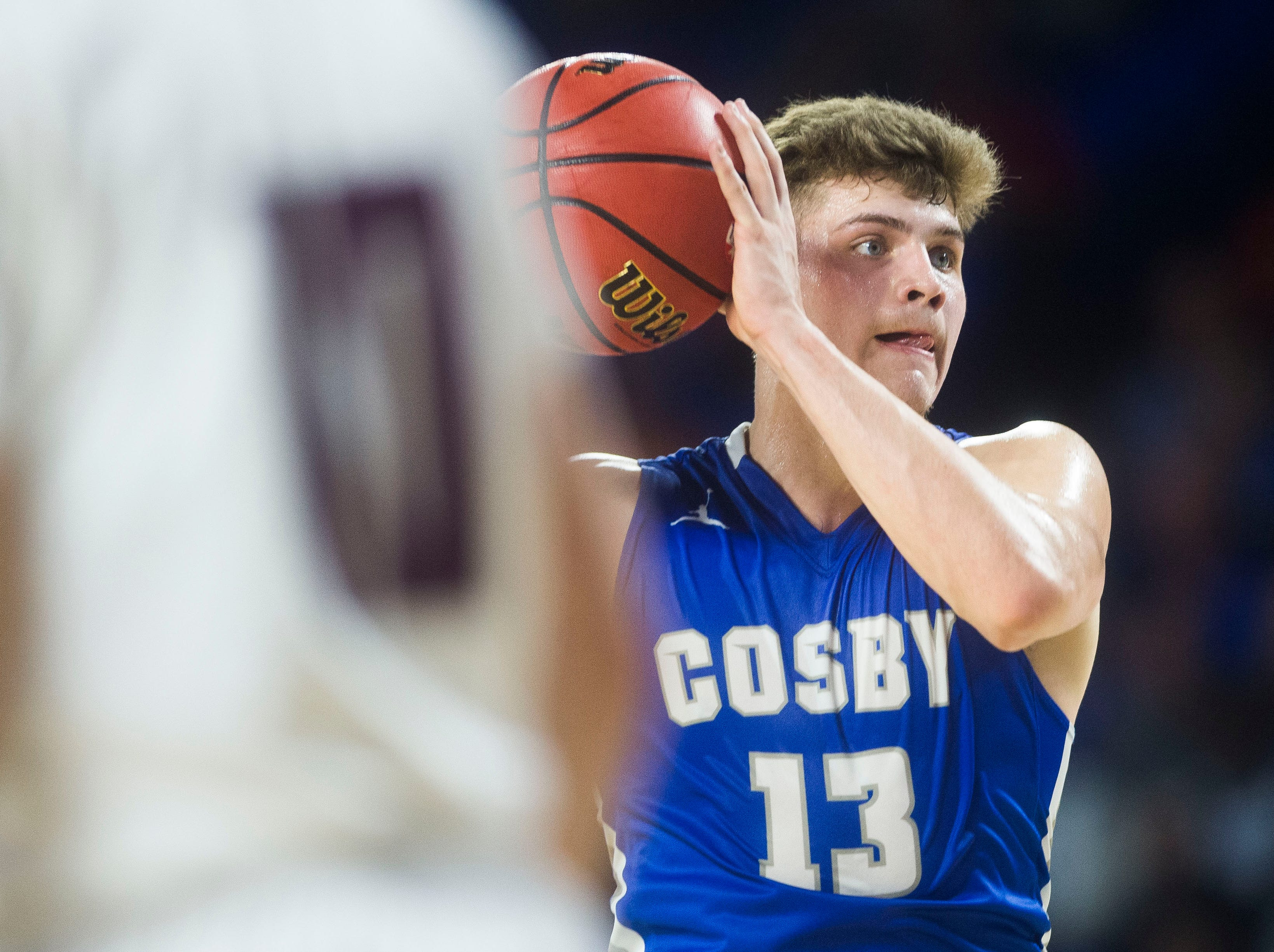 Cosby's Austin McKeehan (13) looks to pass during a TSSAA A state quarterfinal game between Eagleville and Cosby at the Murphy Center in Murfreesboro, Thursday, March 14, 2019.