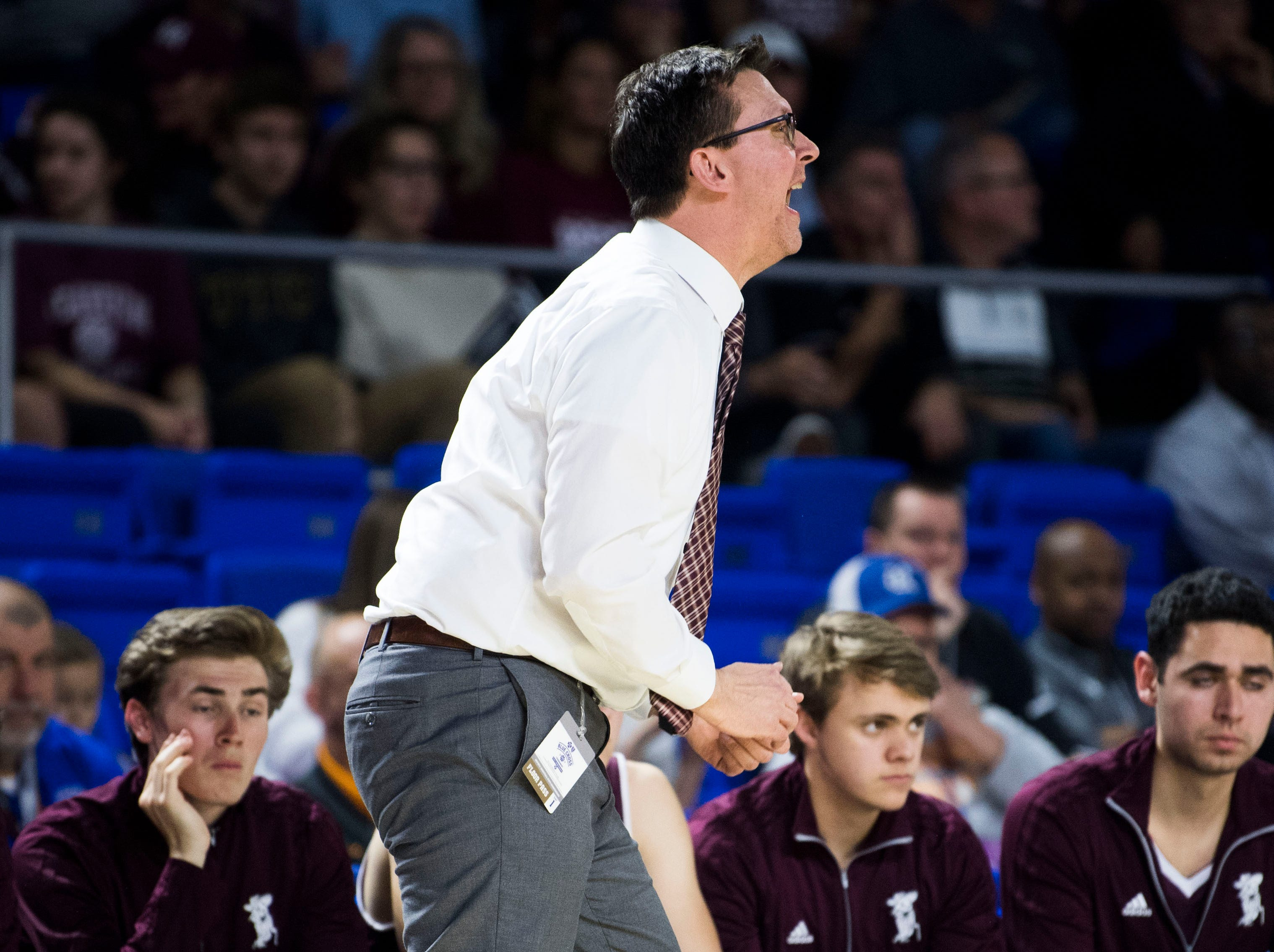 Franklin's head coach Darrin Joines yells to players on the court during a TSSAA AAA state quarterfinal game between Bearden and Franklin at the Murphy Center in Murfreesboro, Wednesday, March 13, 2019.