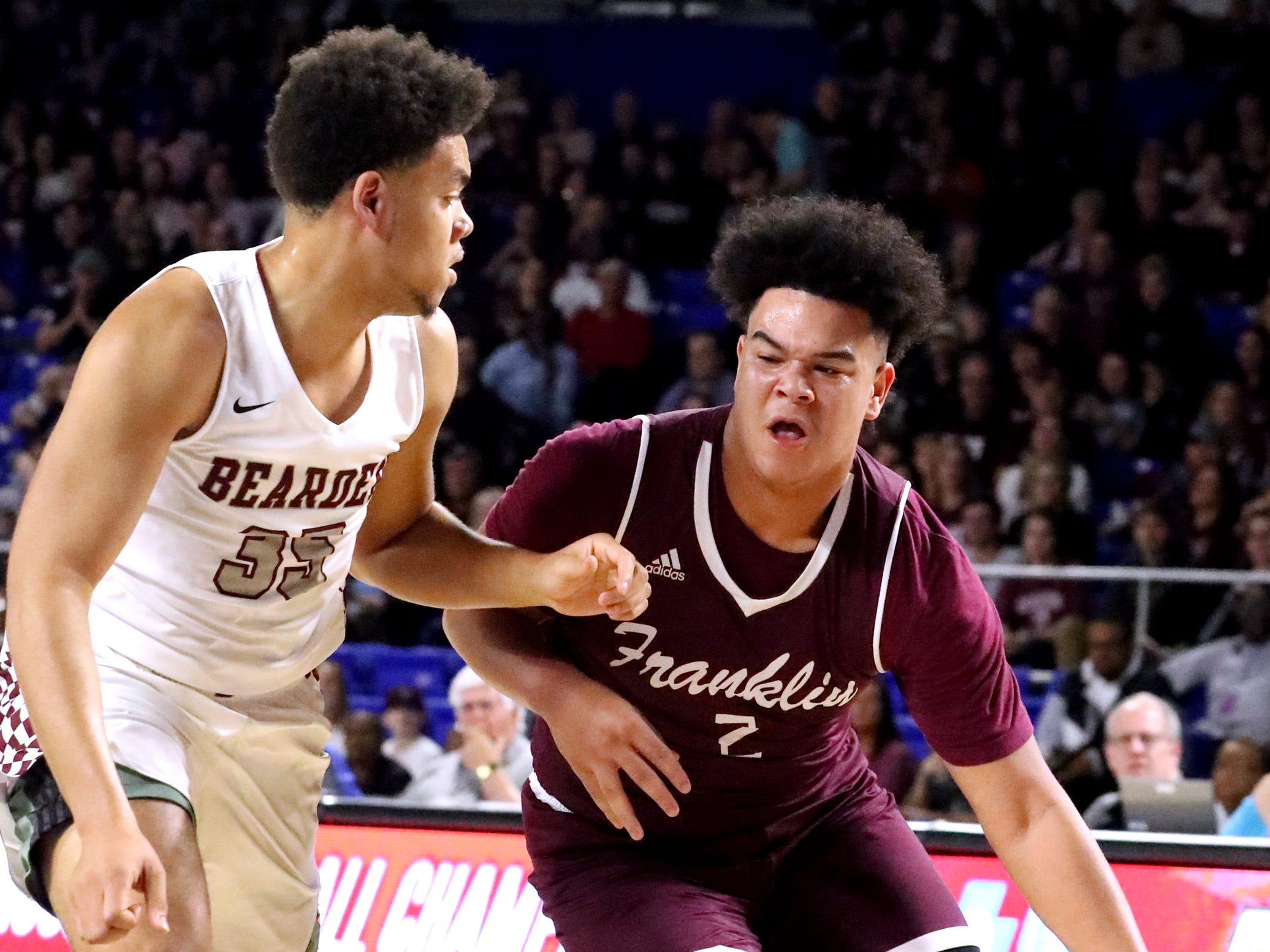 Franklin's Ahsharri Haynesworth (2) drives to the basket as Bearden's Shamarcus Brown (35) guards him during the quarterfinal round of the TSSAA Class AAA Boys State Tournament, on Wednesday, March 13, 2019, at Murphy Center in Murfreesboro, Tenn.