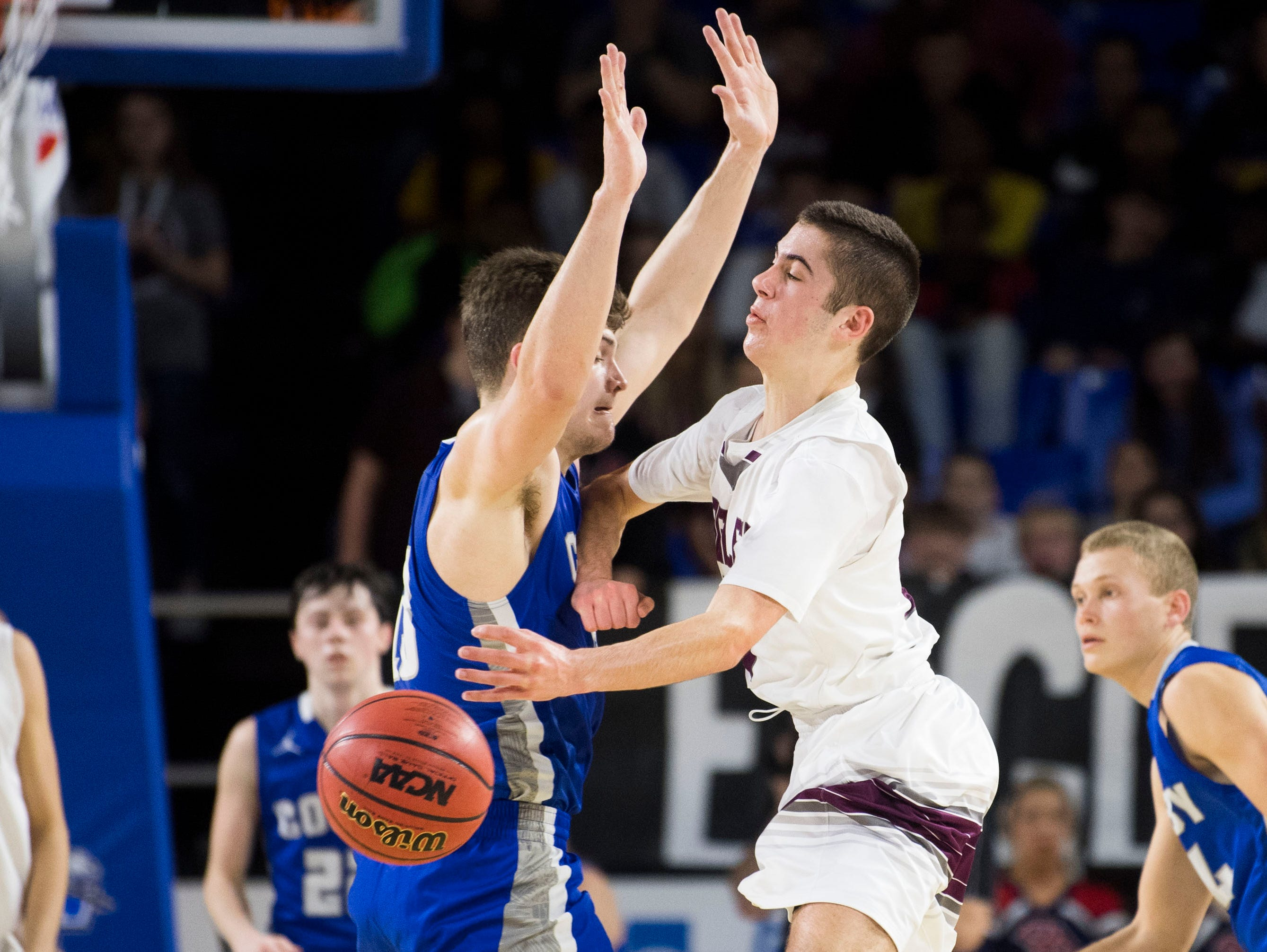 Eagleville's Ryley McClaran (3) passes the ball around Cosby's Austin McKeehan (13) during a TSSAA A state quarterfinal game between Eagleville and Cosby at the Murphy Center in Murfreesboro, Thursday, March 14, 2019. Eagleville defeated Cosby 66-55.
