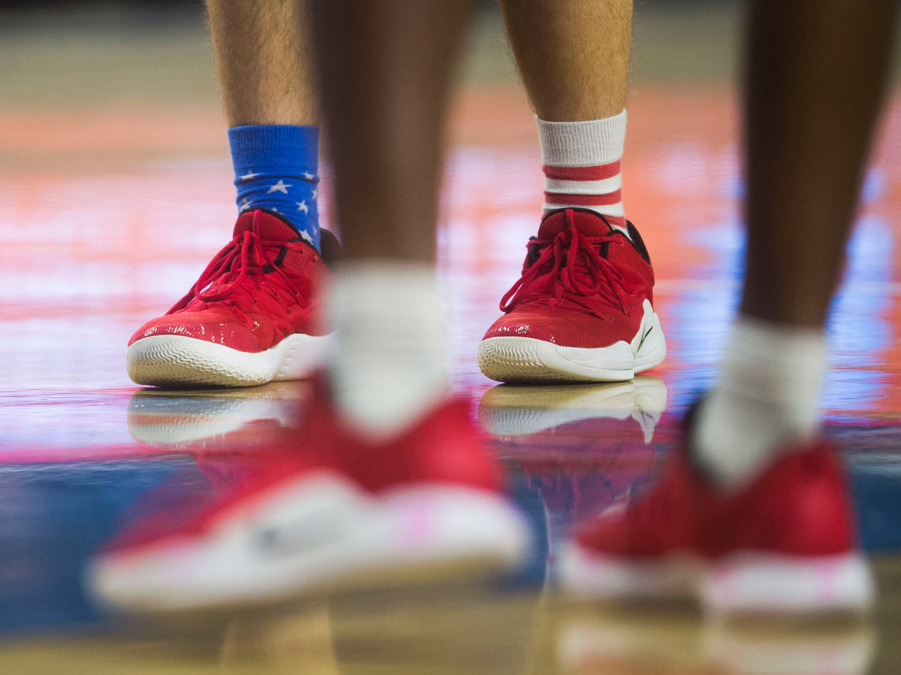 A McKenzie player's socks are visible during a TSSAA A state quarterfinal game between University School and McKenzie at the Murphy Center in Murfreesboro, Thursday, March 14, 2019. McKenzie defeated University School 68-49.